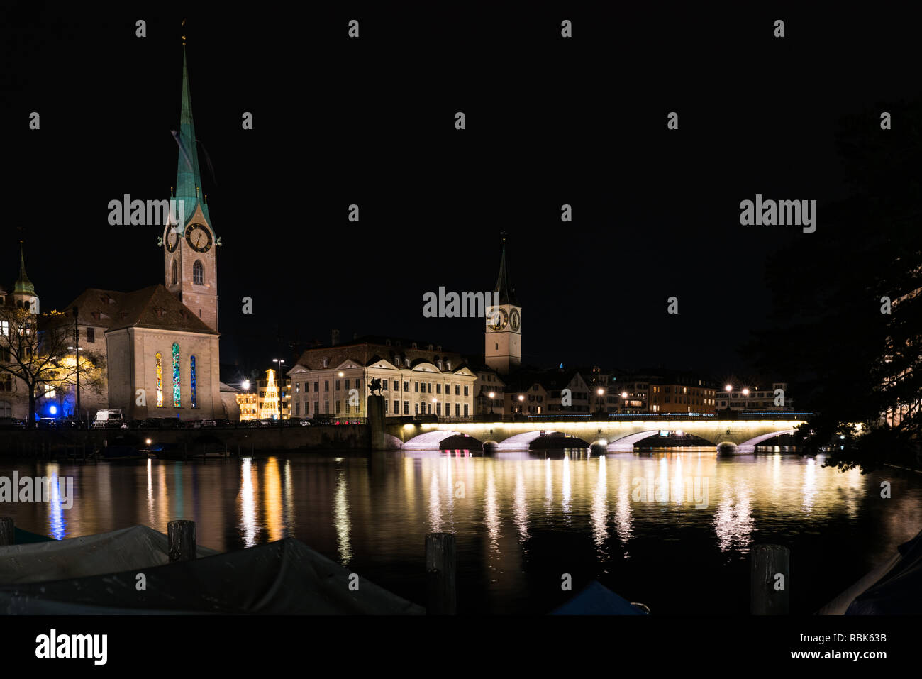 Zurich, ZH / Switzerland - January 4, 2019: night time city skyline view of Zurich with the river Limmat in winter Stock Photo