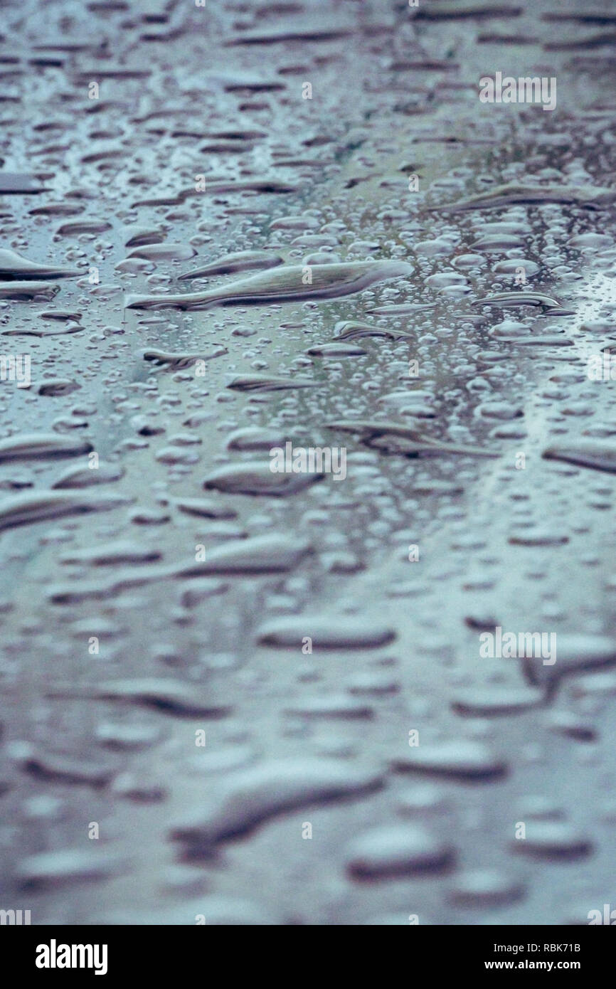 Closeup Of Water Drops On A Metal Surface Stock Photo