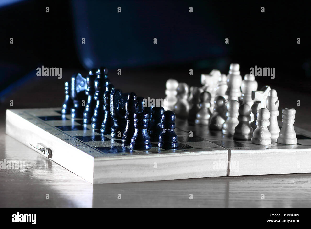 chess composition on dark background. strategy concept - Stock Image