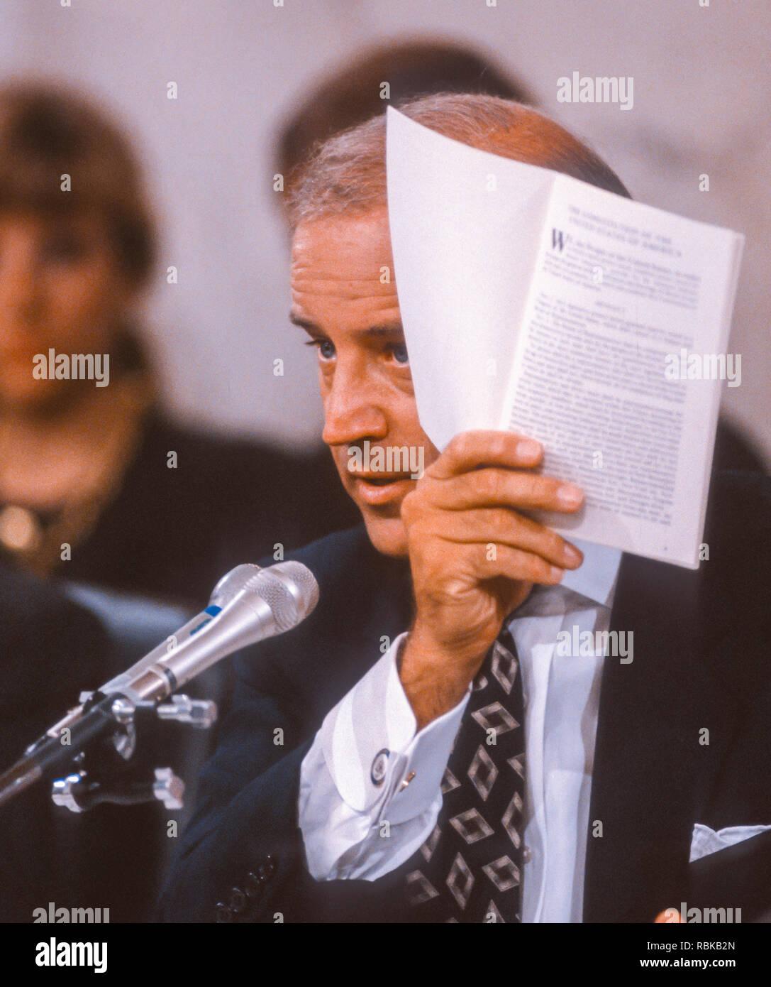 WASHINGTON, DC, USA - SEPTEMBER 12, 1991: Senator Joseph Biden (D-DE), Chairman U.S. Senate Judiciary Committee, shows Constitution, during Clarence Thomas hearing. - Stock Image