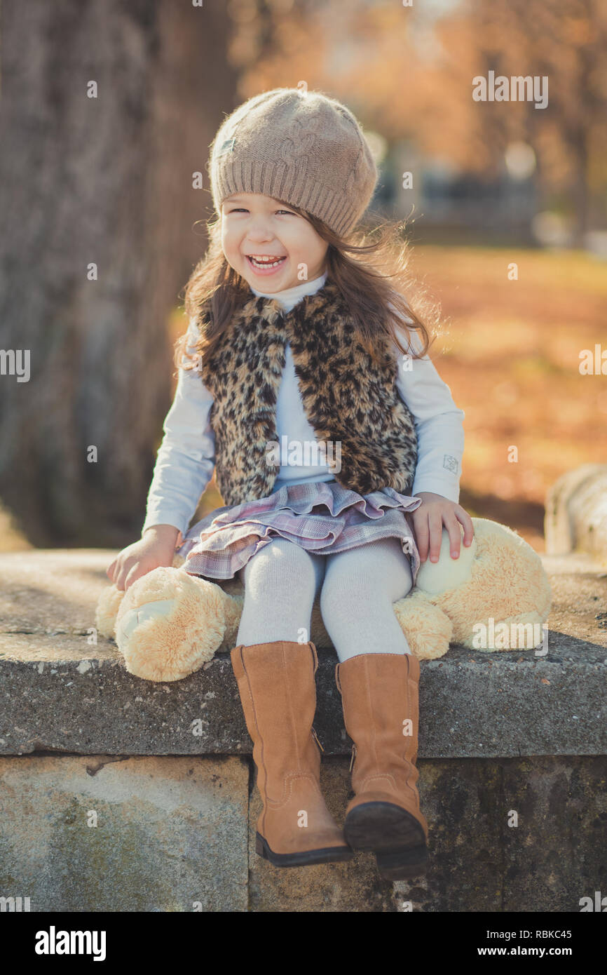 bee93cccc Dolly pin-up toothsome young brunette girl wearing fashion stylish gray  jacket jerkin and warm hat with awesome boots clothes posing autumn spring  par