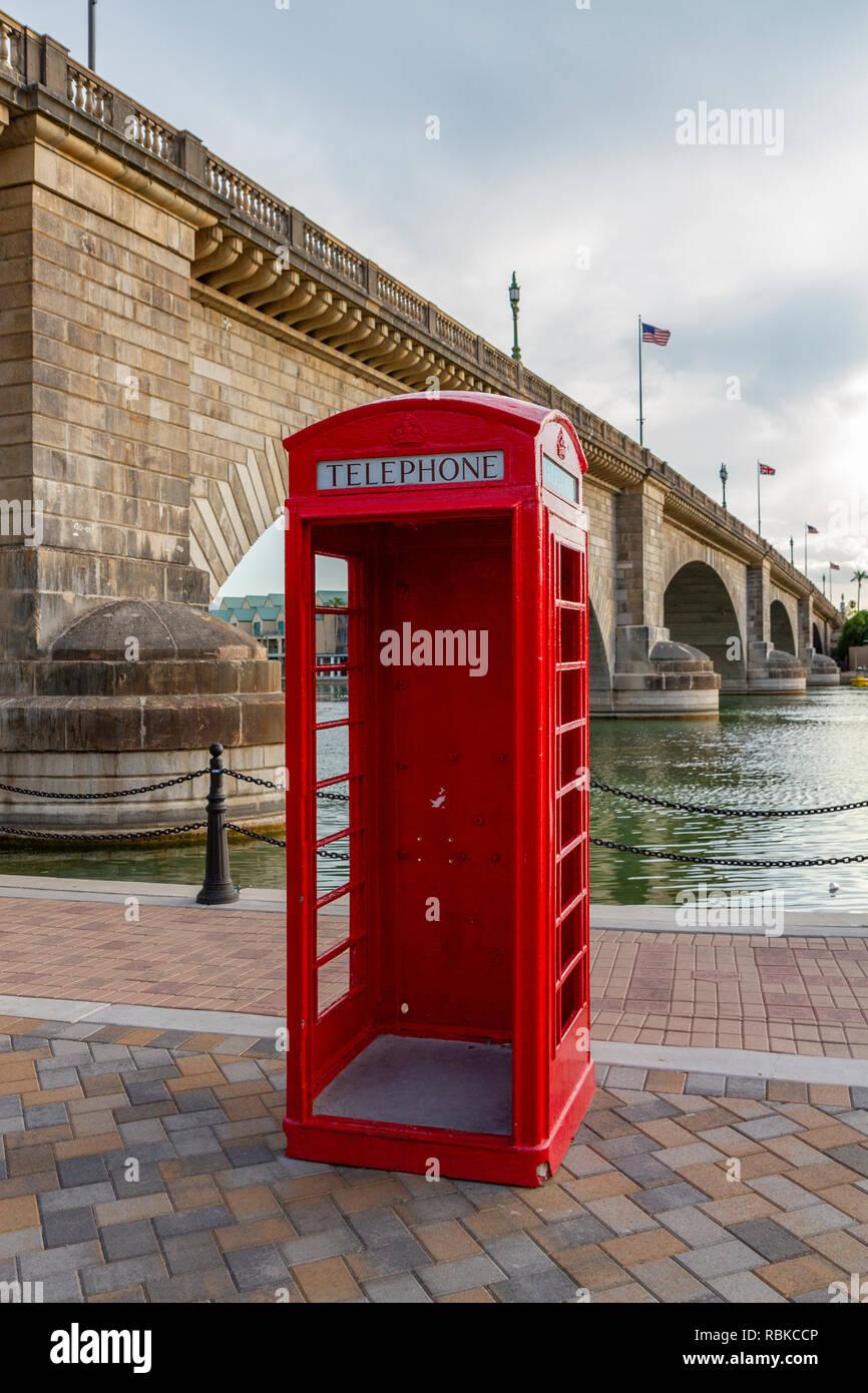 A traditional British telephone kiosk (phone box) beside London Bridge in Lake Havasu City, western Arizona, United States. - Stock Image