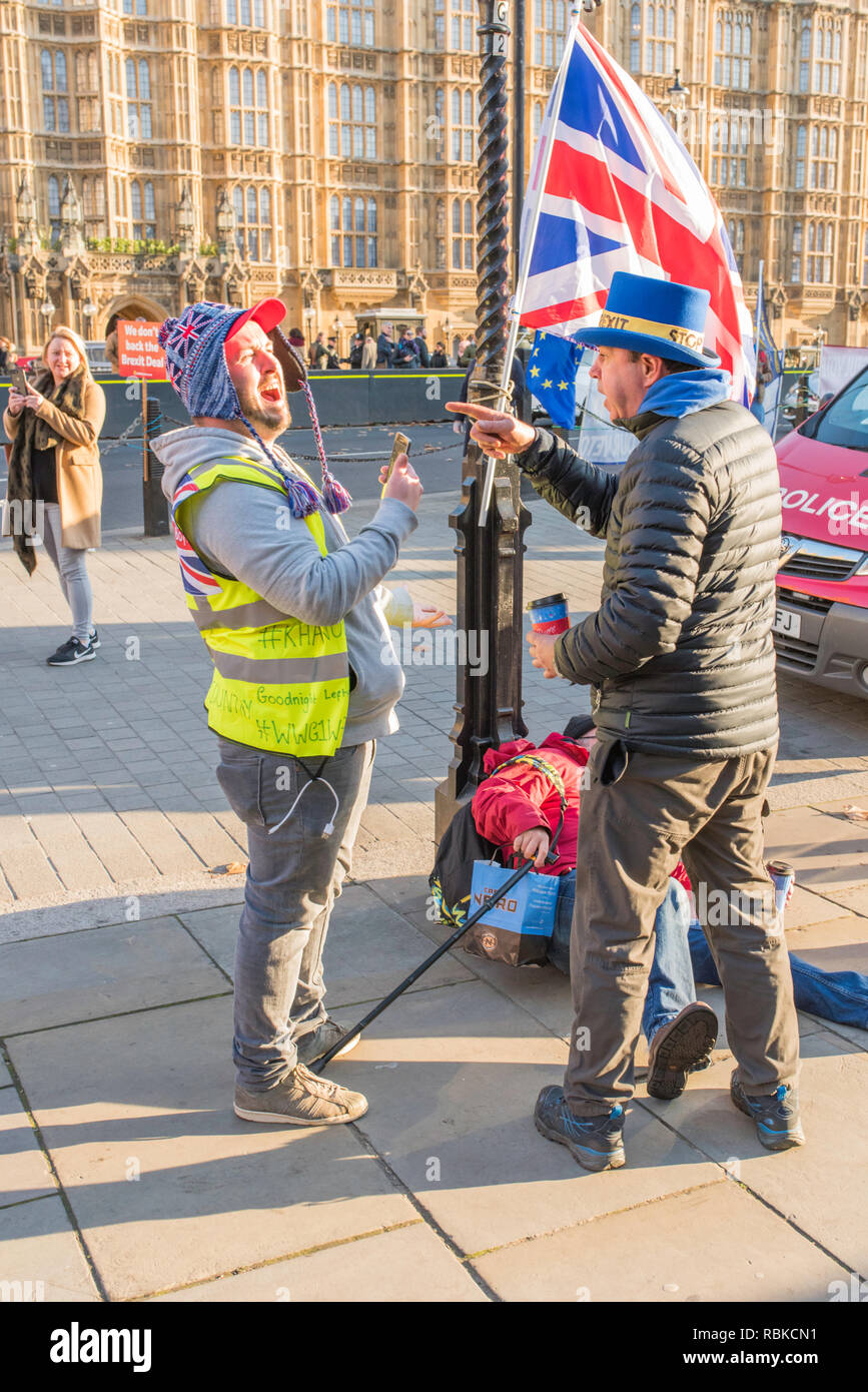 Brexit argument involving Steve Bray outside the Houses of Parliament, Abingdon Street, London, UK. - Stock Image