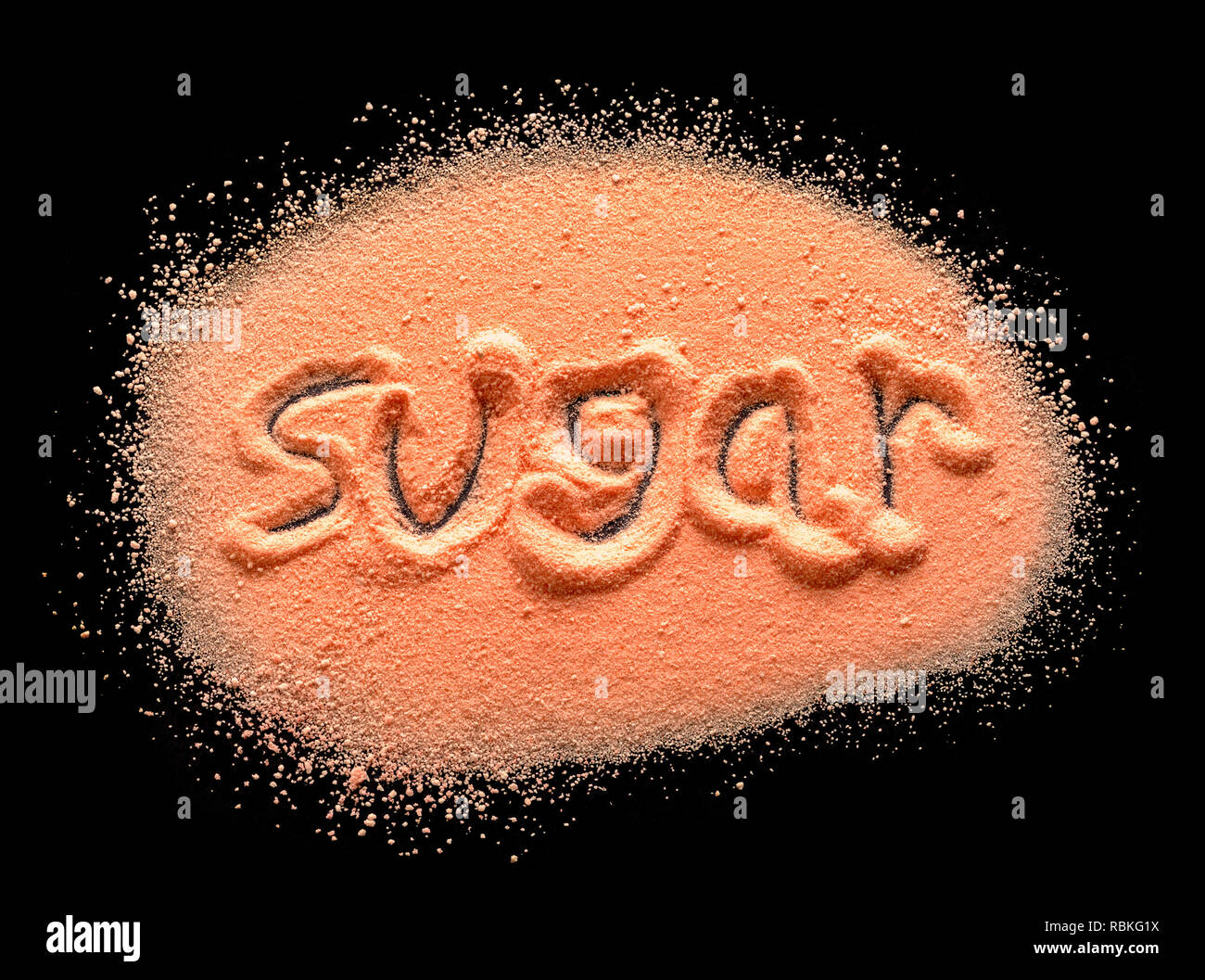 Word Sugar Written in Orange Candy Powder on Black. - Stock Image