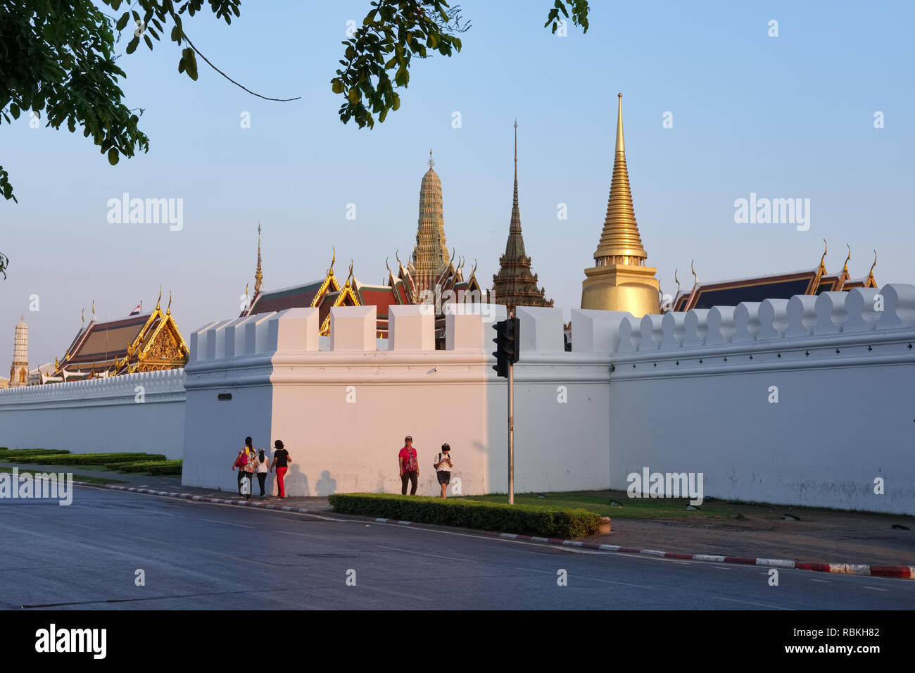Wat Phra Kaew (Gaew) and Grand Palace in Bangkok, Thailand, home of the Jade Buddha and the country's most revered temple, seen from its northern wall - Stock Image