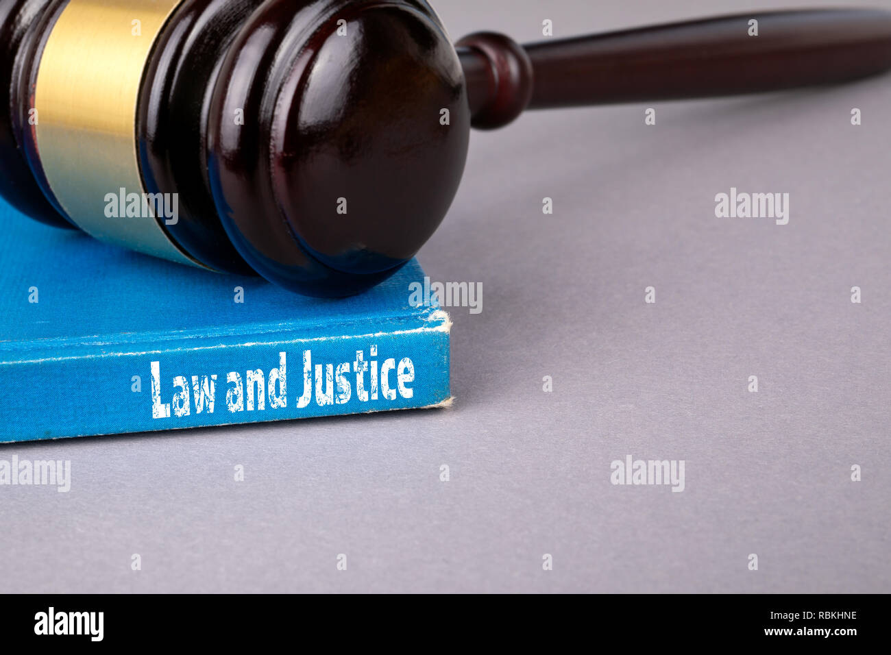 Law and justice concept. blue book on a gray office table - Stock Image