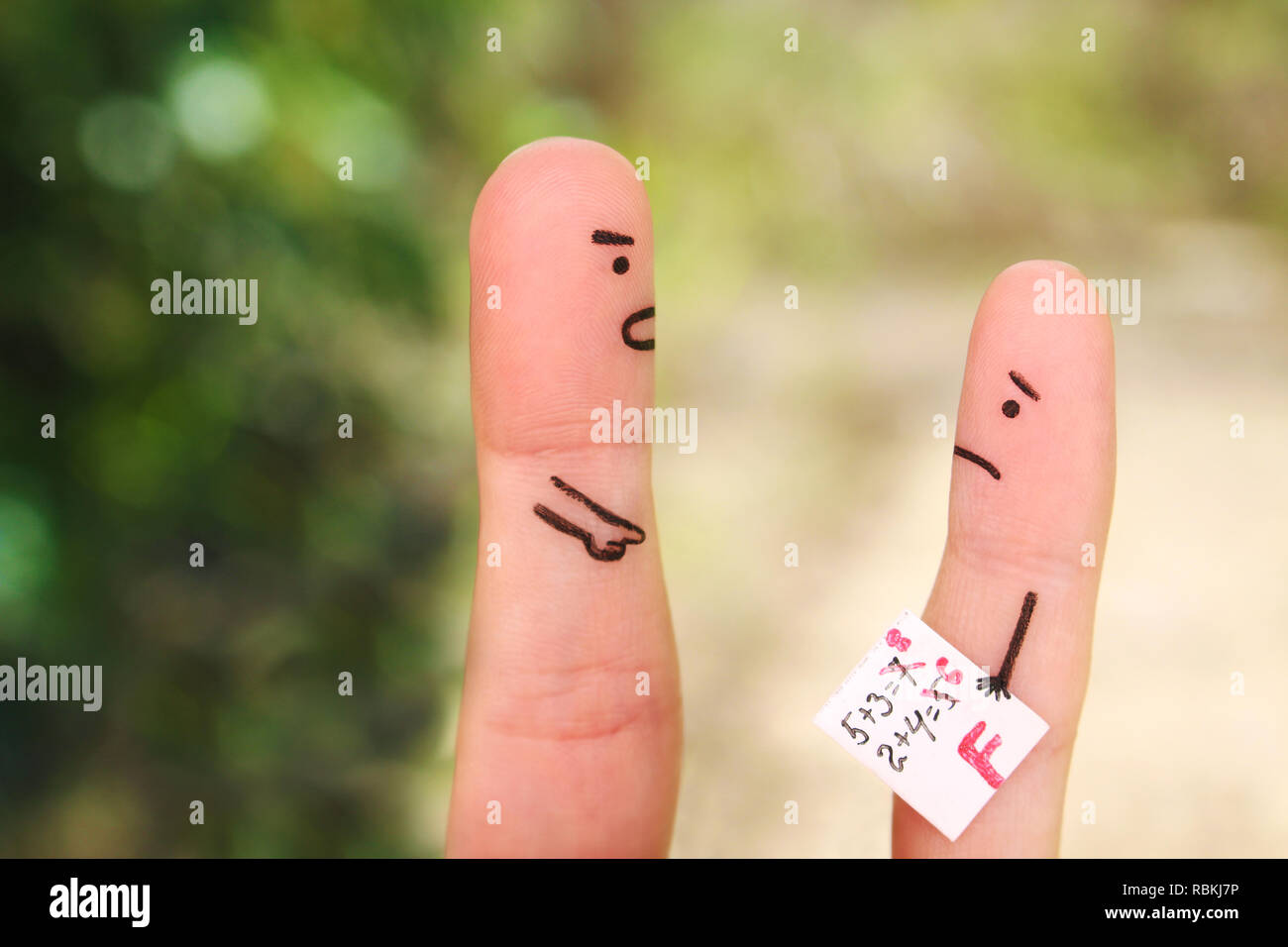 Fingers art of people. Concept of boy got a bad grade, man scolding child. - Stock Image