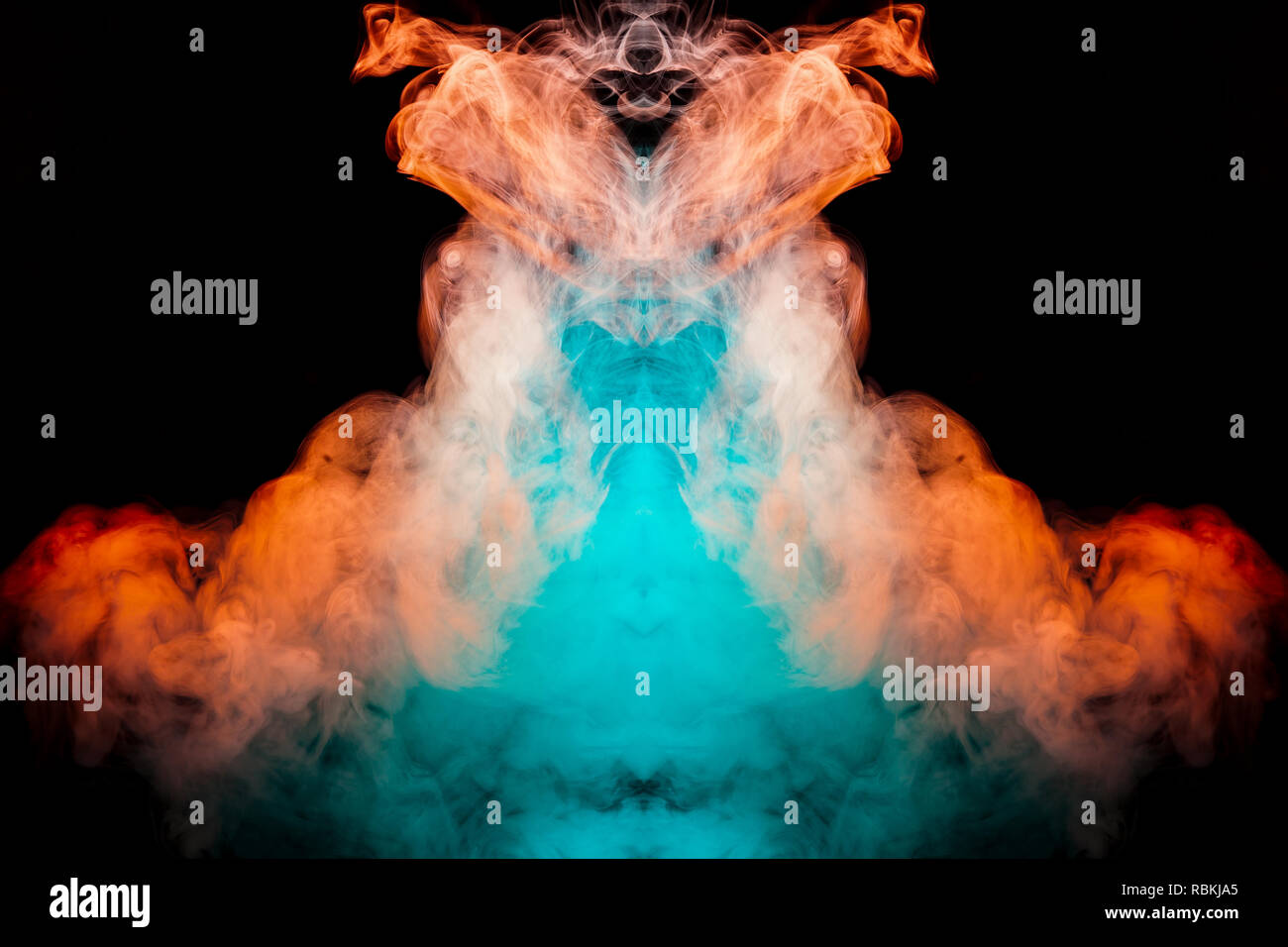 Multicolored curling smoke rising upwards in a pillar, red blue vapor twisting into abstract shapes and patterns on a black background, repeating the  - Stock Image