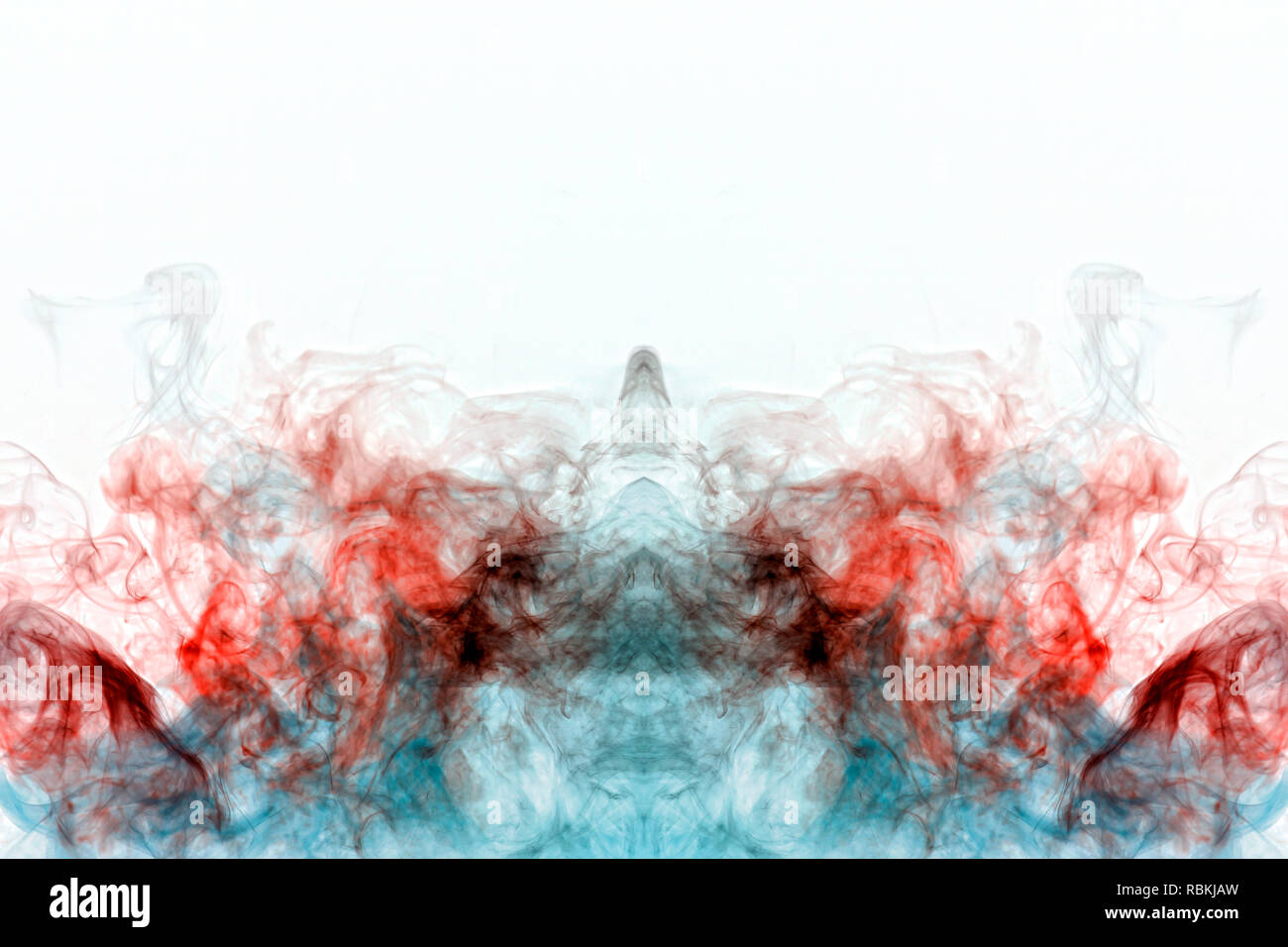 Multicolored curling smoke, red blue vapor, curled into abstract shapes and patterns on a white background, repeating the movement of waves and a chem - Stock Image