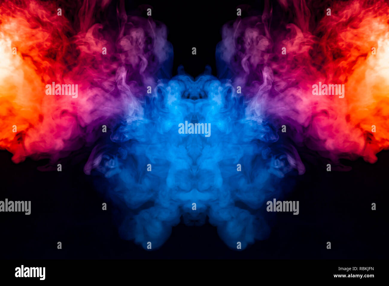 Curling smoke evaporating curls in the form of a spectacular, mystical head, highlighted with blue, red, purple on an isolated black background patter - Stock Image
