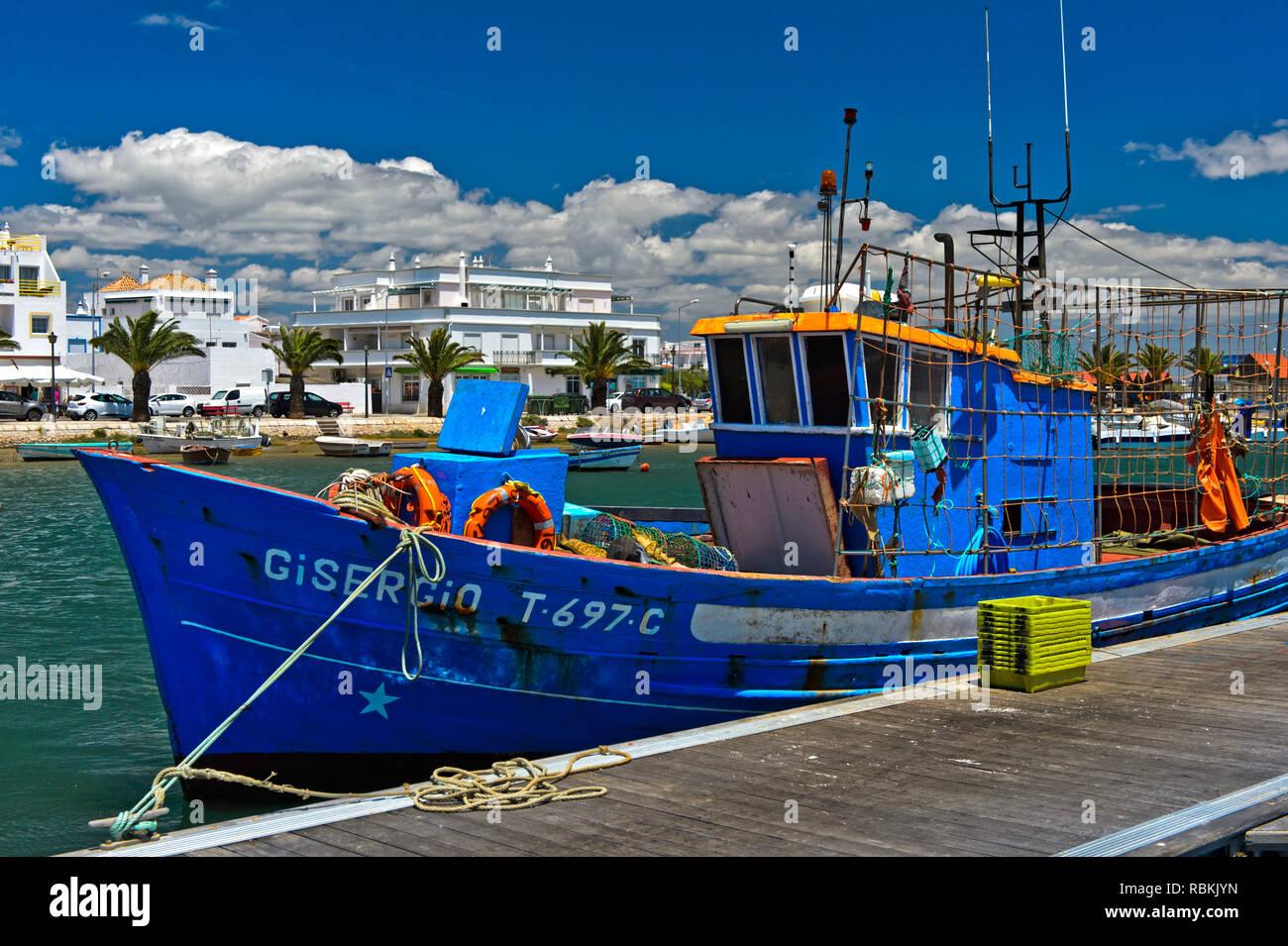 Fishing vessel in the harbour of Santa Luzia, Algarve, Portugal Stock Photo