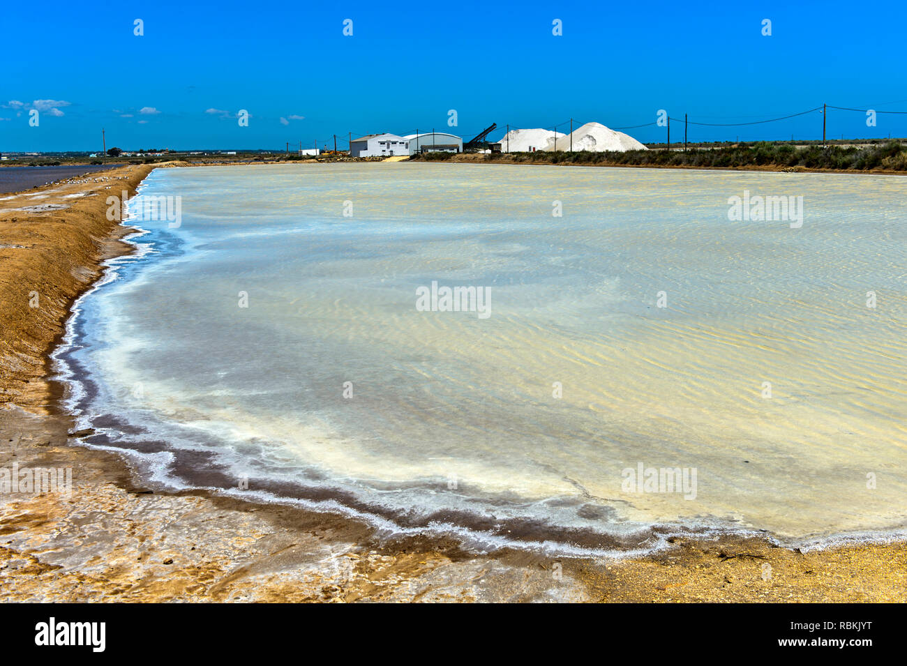 Sea salt production, salt evaporation ponds, Sopursal saline, Santa Luzia, Algarve, Portugal Stock Photo