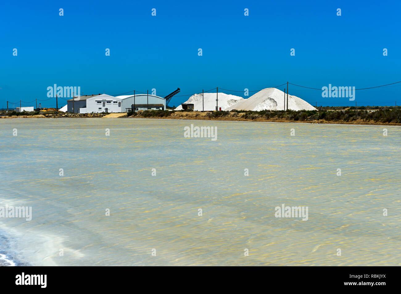 Sea salt production, salt evaporation ponds, Sopursal saline, Santa Luzia, Algarve, Portugal - Stock Image