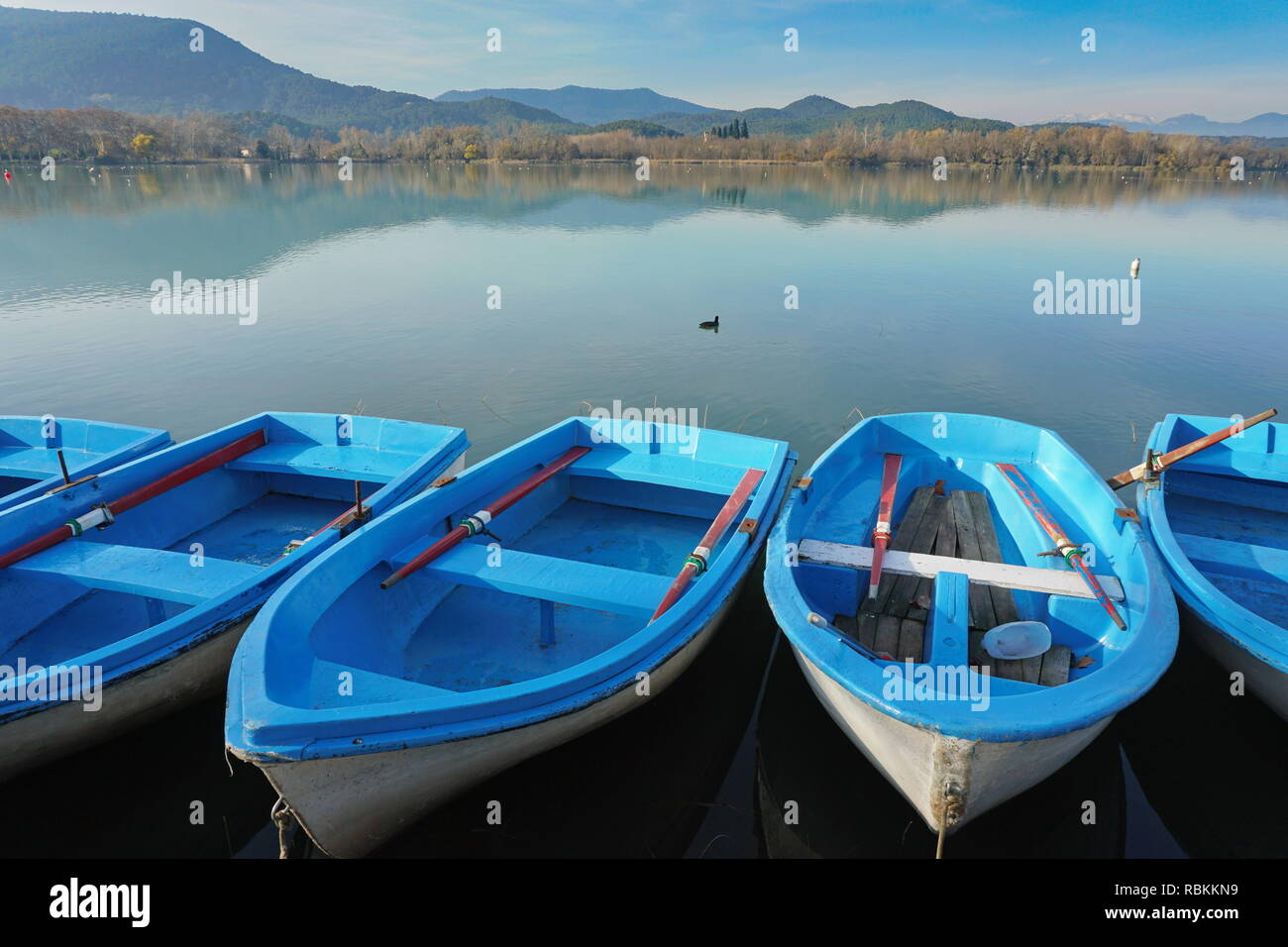 The lake of Banyoles with small boats in foreground, Province of Girona, Catalonia, Spain Stock Photo