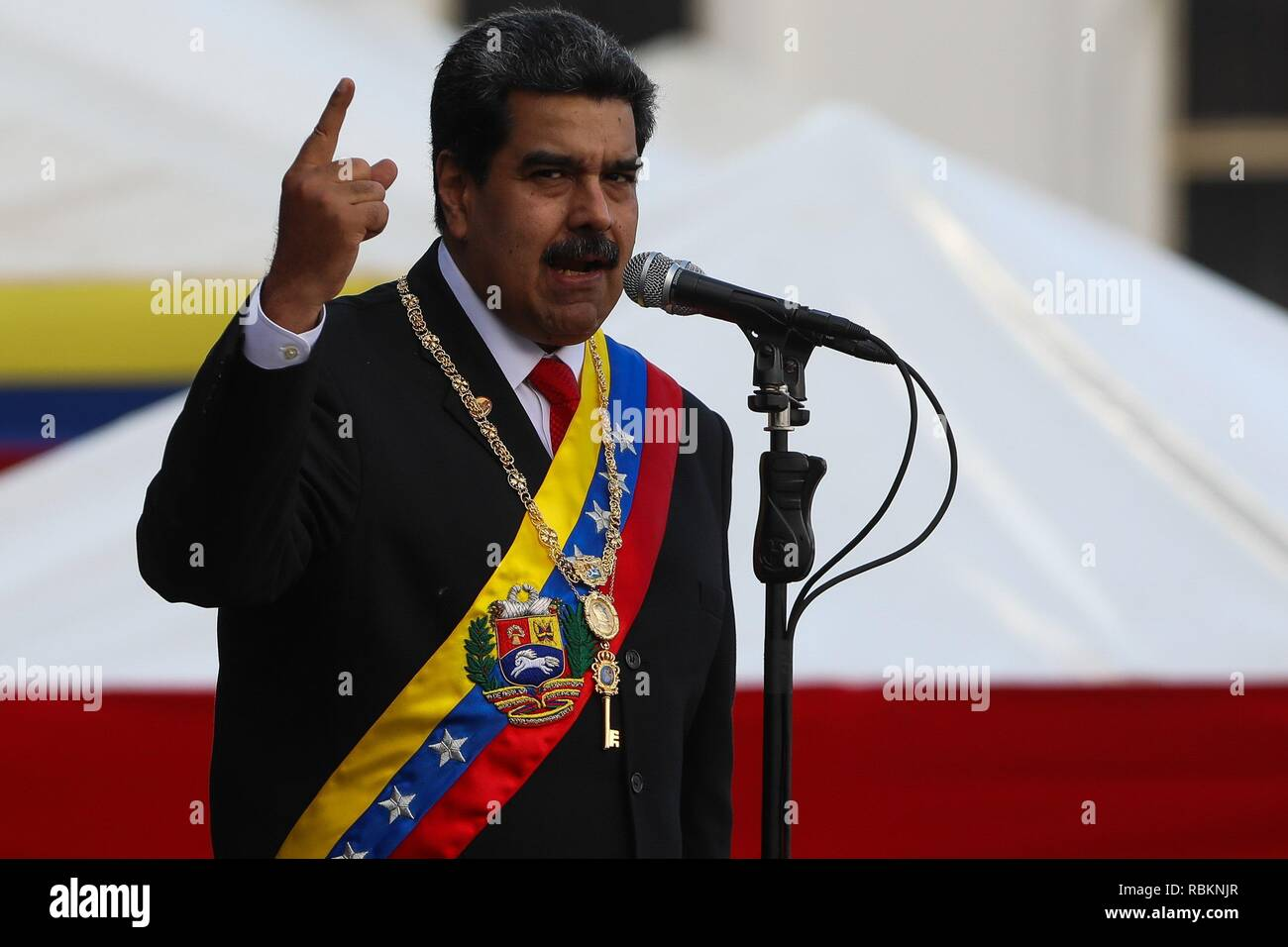Caracas, Venezuela. 10th Jan, 2019. Venezuelan President Nicolas Maduro participates in a ceremony to swear in the Armed Forces for his second term, in Caracas, Venezuela, 10 January 2019. Maduro said he is ready for six more years in power as a 'democrat' after taking office for a second term amid wide questioning of the local opposition and a great part of the international community. Credit: Cristian Hernandez/EFE/Alamy Live News - Stock Image