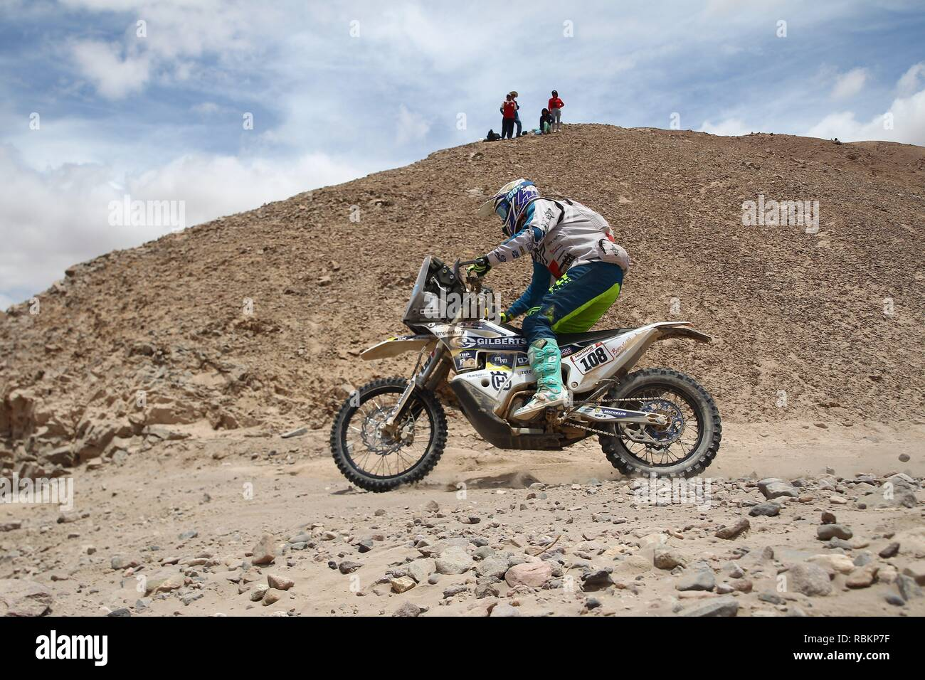 Tacna, Peru. 10th Jan, 2019. South African Kenneth Gilbert rides his Husqvarna during the fourth stage of the Rally Dakar 2019 between Arequipa and Tacna, in Peru, 10 January 2019. Credit: Ernesto Arias/EFE/Alamy Live News - Stock Image
