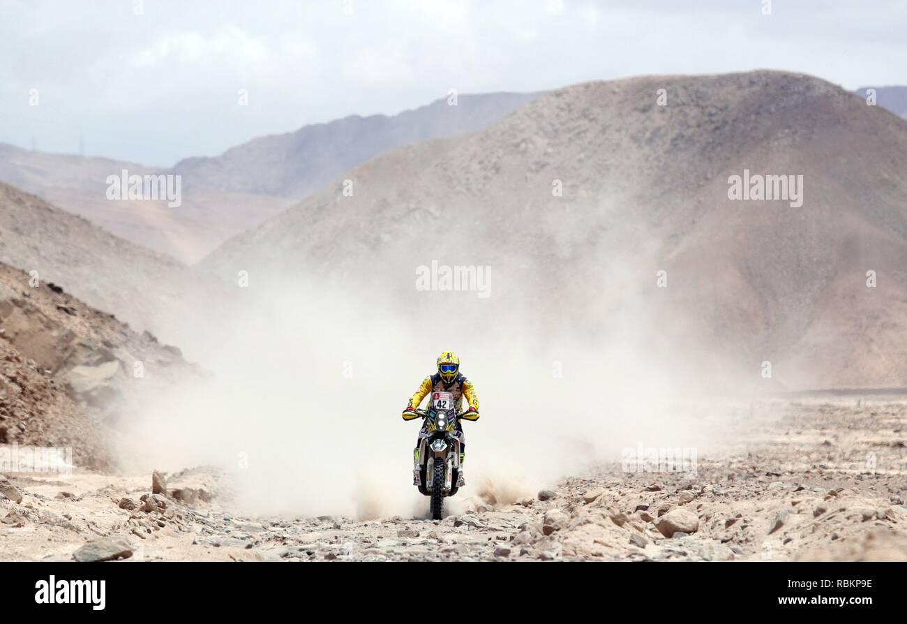 Tacna, Peru. 10th Jan, 2019. Italian Maurizio Gerini rides his Husqvarna during the fourth stage of the Rally Dakar 2019 between Arequipa and Tacna, in Peru, 10 January 2019. Credit: Ernesto Arias/EFE/Alamy Live News - Stock Image