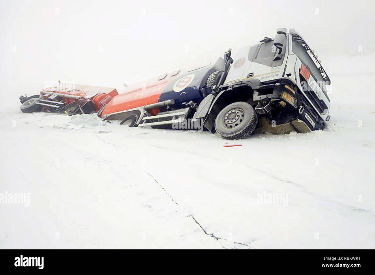 Russia. 11th Jan, 2019. SAKHA REPUBLIC (YAKUTIA), RUSSIA - JANUARY 11, 2019: A petrol truck fallen through the ice on the Aldan River while driving along an authorized river crossing site near the Megino-Aldan settlement in the Tomponsky District. The Sakha Republic (Yakutia) Branch of the Russian Emergency Situations Ministry/TASS Credit: ITAR-TASS News Agency/Alamy Live News - Stock Image