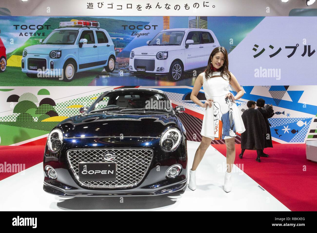 Exhibition Booth Assistant : Chiba japan th jan a booth assistant poses for a