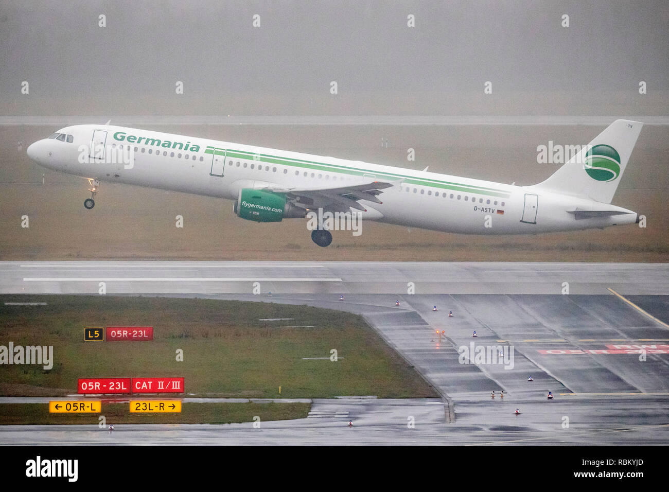 11 January 2019, North Rhine-Westphalia, Düsseldorf: An aircraft of the airline Germania takes off at Düsseldorf Airport in Regen. Germania had confirmed financial difficulties on 08.01.2019. As a result, the airline is reviewing several financing options to secure short-term liquidity needs. However, there should be no restrictions on flight operations. Photo: Marcel Kusch/dpa - Stock Image