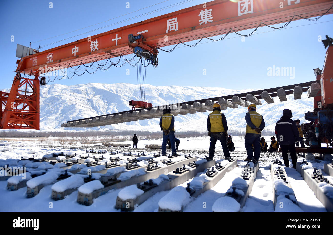 (190111) -- LHASA, Jan. 11, 2019 (Xinhua) -- Staff members work at the construction site of the Lhasa-Nyingchi section of the Sichuan-Tibet Railway in southwest China's Tibet Autonomous Region, on Dec. 23, 2018. In 2018, an investment of 4.2 billion yuan (623 million U.S. dollars) was made in railway construction in the region. (Xinhua/Chogo) - Stock Image