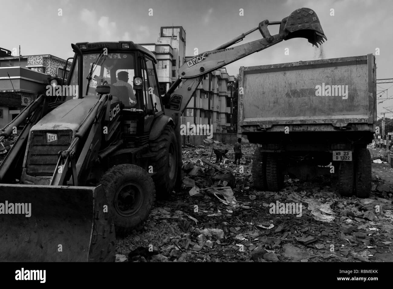 Slums demolished, JCB bulldozer, Kolkata, West Bengal, India, Asia - Stock Image