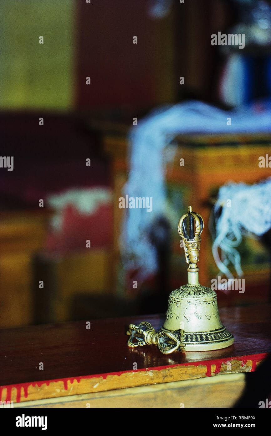 Buddhism bell on table, Himachal Pradesh, India, Asia - Stock Image
