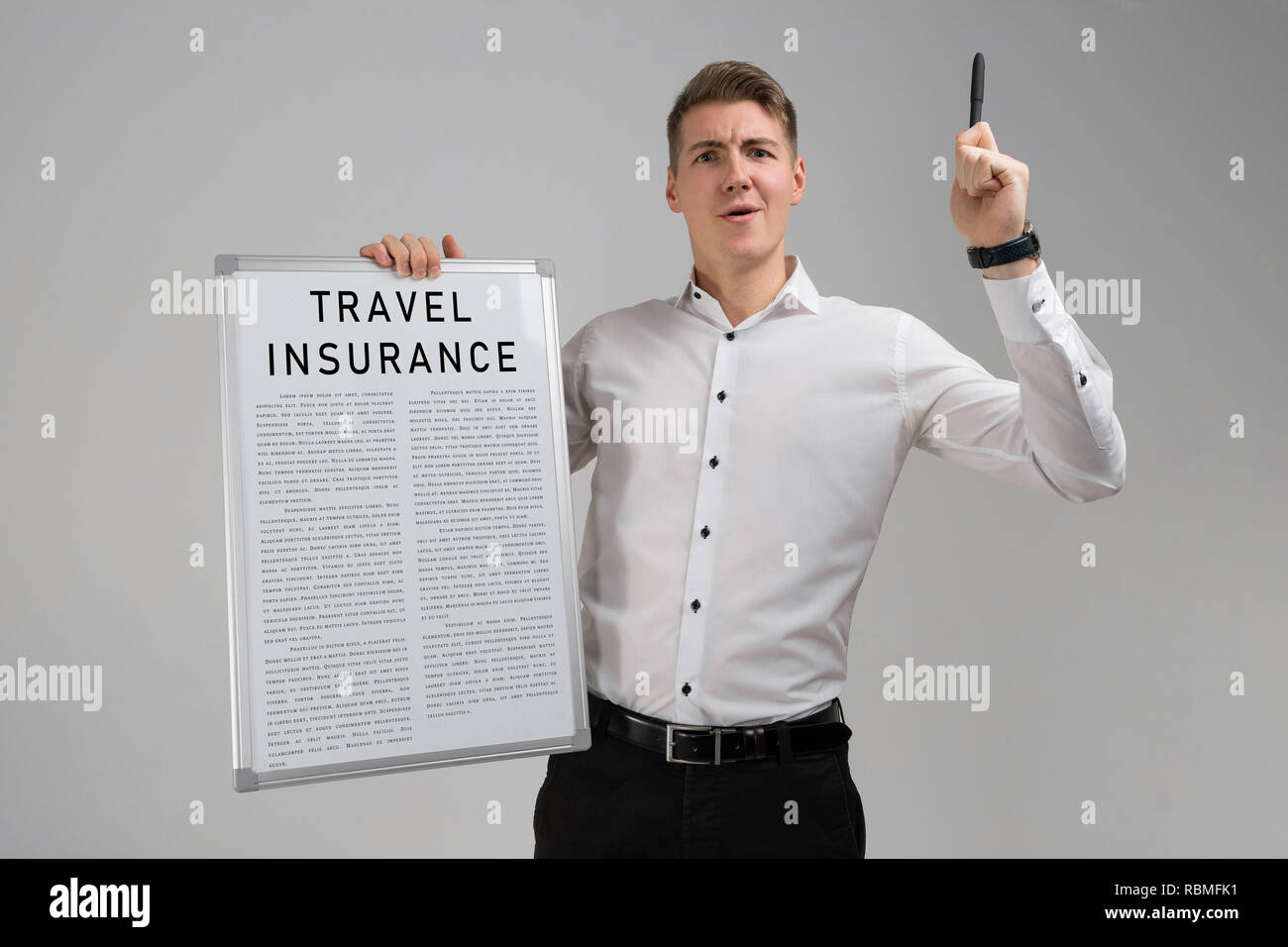 Young man holding a travel insurance list isolated on light background - Stock Image