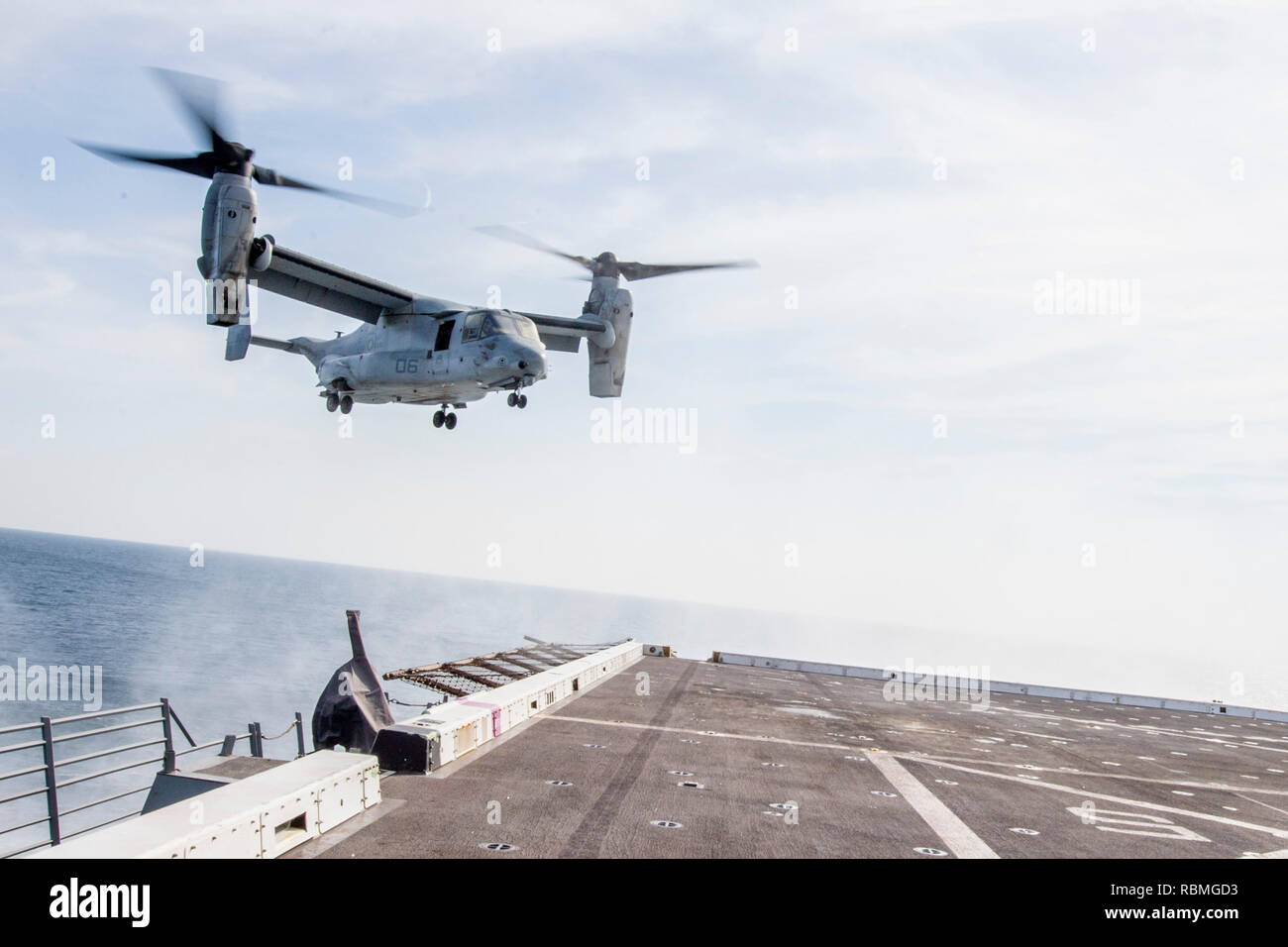 190102-N-PH222-1095 ARABIAN SEA (Jan. 2, 2018) An MV-22 Osprey tiltrotor aircraft, attached to Marine Medium Tiltrotor Squadron (VMM) 166 (Reinforced), prepares to land on the flight deck of the San Antonio-class amphibious transport dock ship USS Anchorage (LPD 23). Anchorage is on a deployment of the Essex Amphibious Ready Group (ARG) and 13th Marine Expeditionary Unit (MEU). The Essex ARG/13th MEU is flexible and persistent Navy-Marine Corps team deployed to the U.S. 5th Fleet area of operations in support of naval operations to ensure maritime stability and security in the Central Region,  - Stock Image