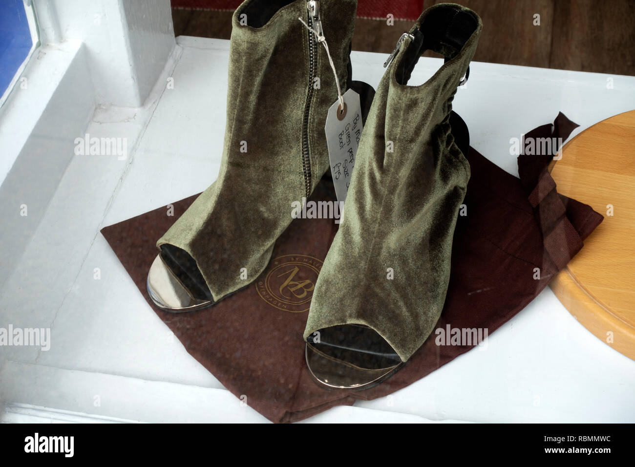 Green peep boots by Malene Birger Stock Photo