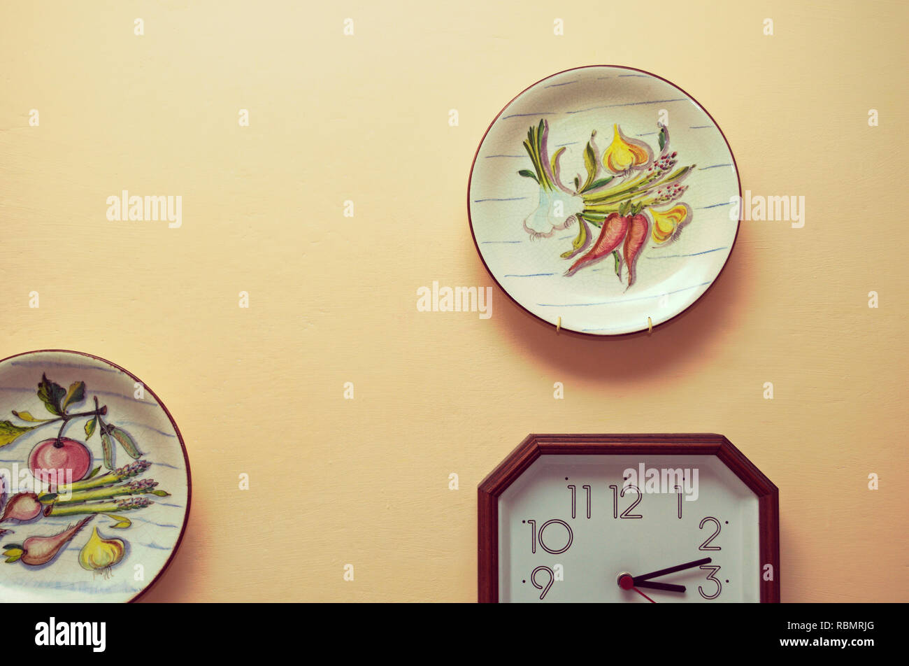Kitchen Wall With Decorative Plates And Clock Stock Photo Alamy