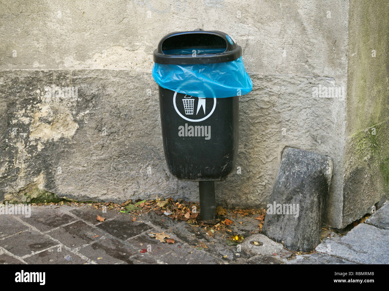 garbage bin on the street in Italy - Stock Image