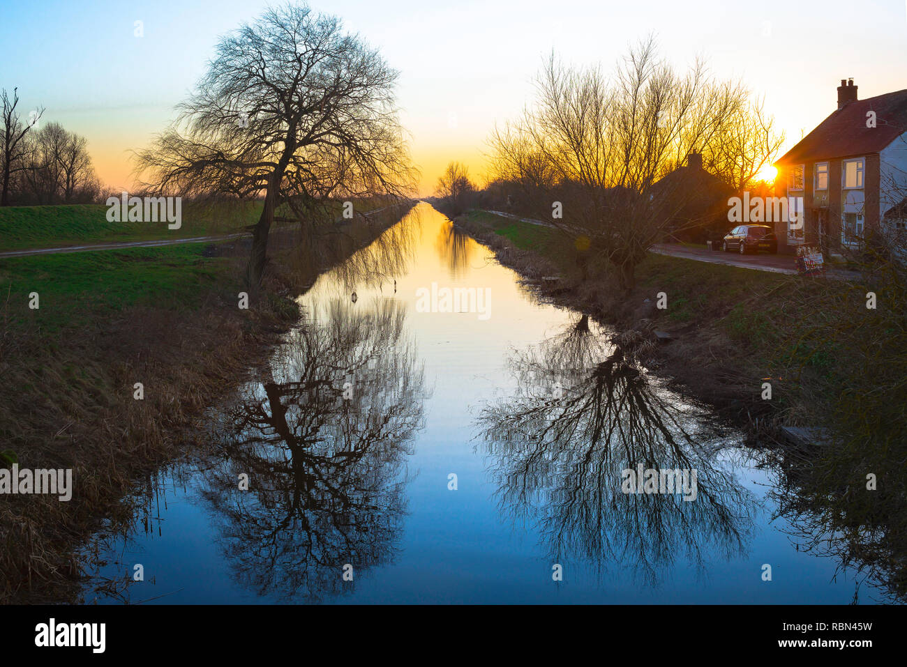 Fens Cambridgeshire UK, sunset view of Vermuydens's Drain (1630)  - a man-made waterway running straight across the Cambridgeshire fens for 20 miles. - Stock Image