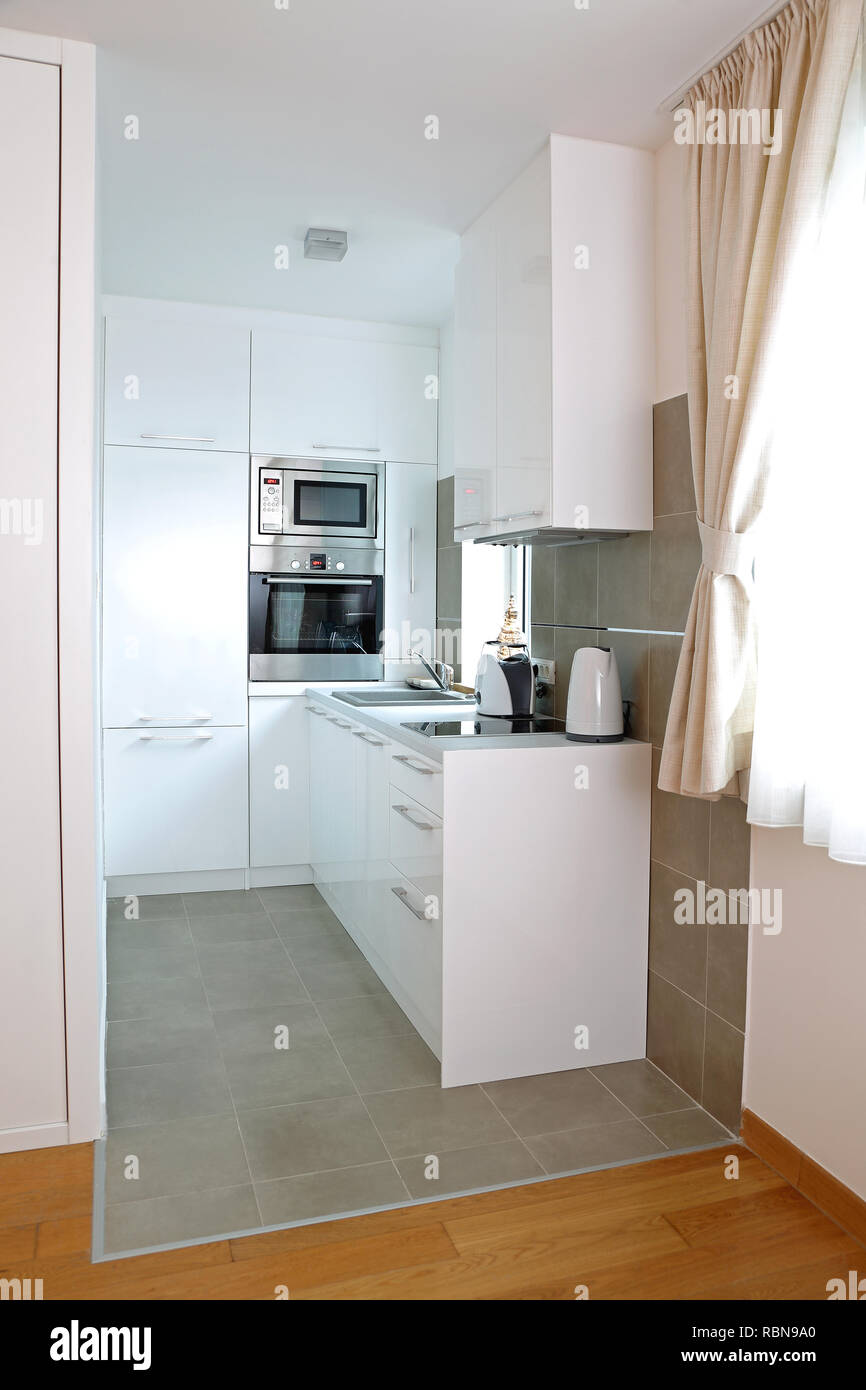 Small White Kitchen in Modern Apartment Stock Photo ...