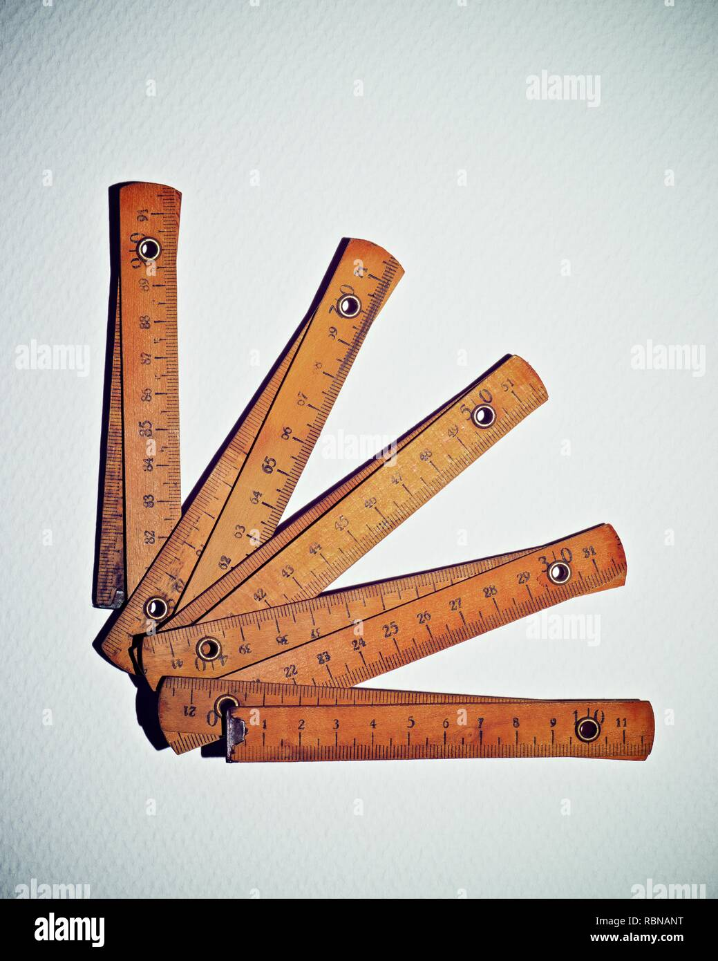 Carpenter meter on a white paper. - Stock Image