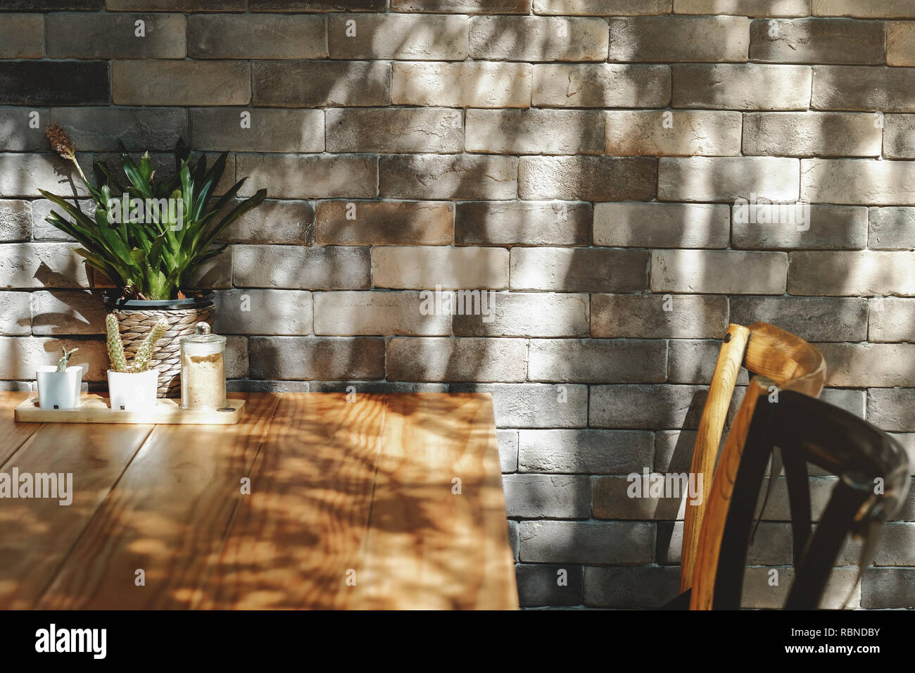 Brick Wall in Restaurant and Cafe, Contemporary Interior Design. Natural Daylight - Stock Image