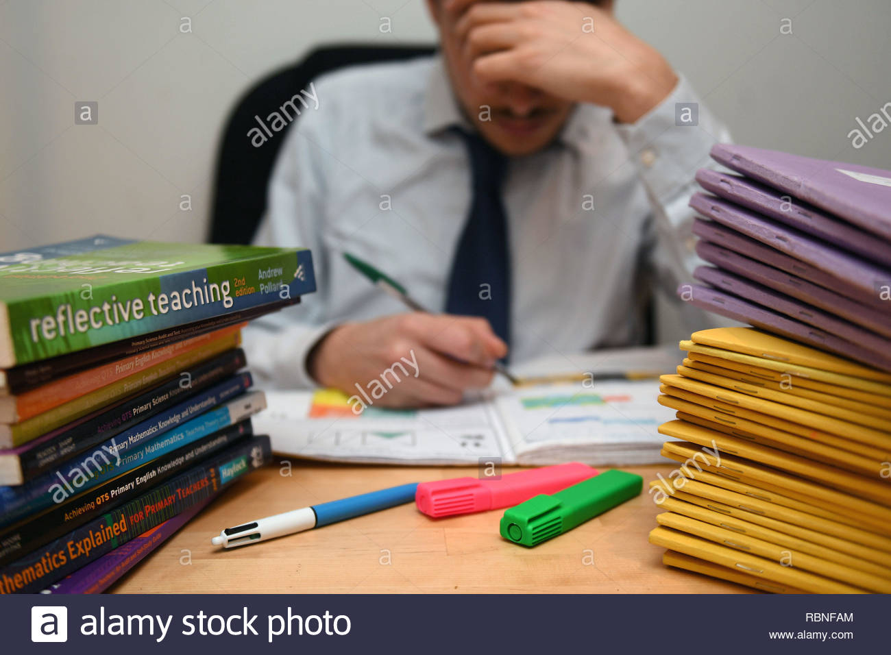 File photo dated 05/03/17 of a teacher next to a pile of