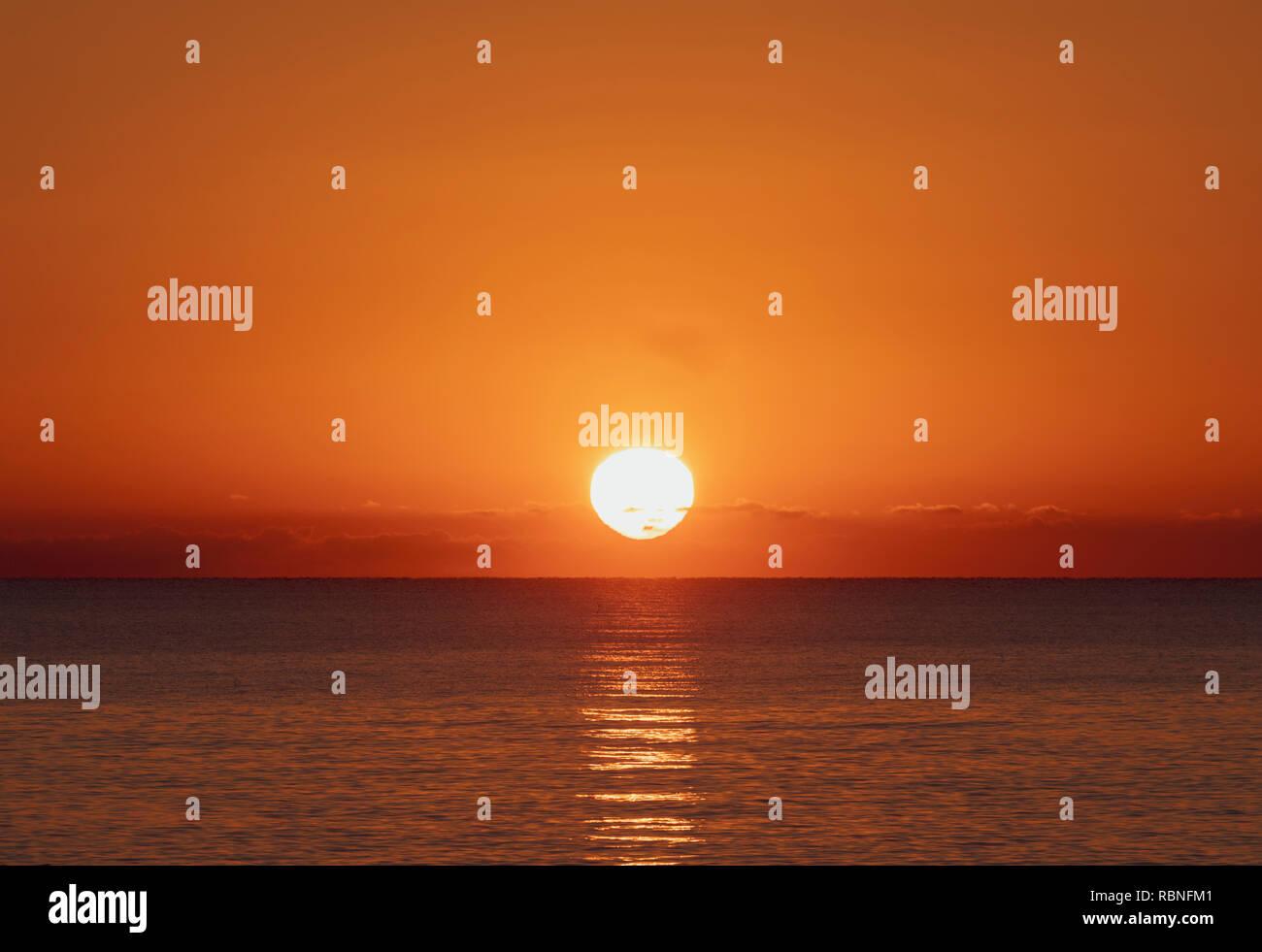 Sunrise over the sea. - Stock Image