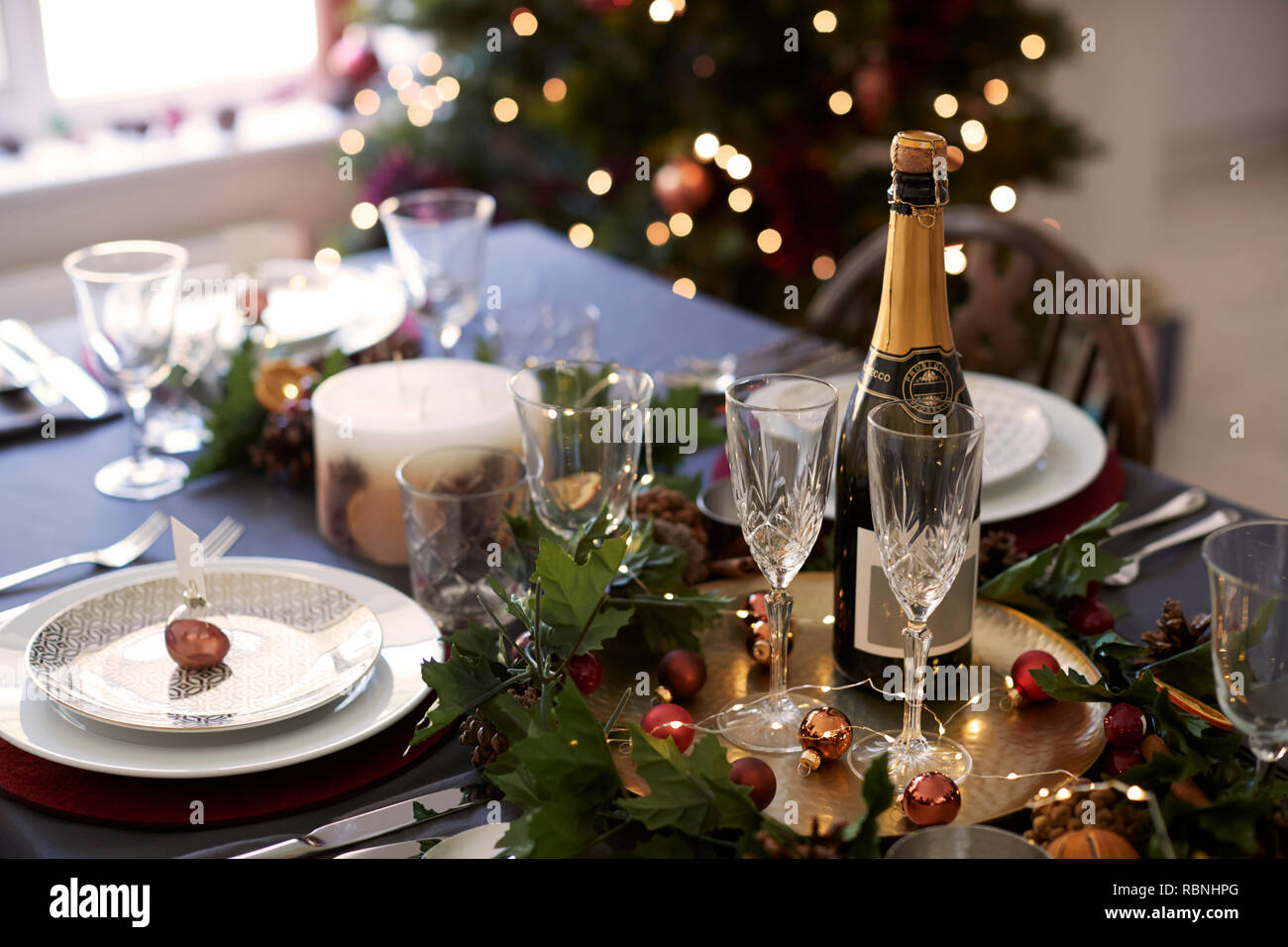 Christmas Table Settings.Christmas Table Setting With Glasses And A Bottle Of