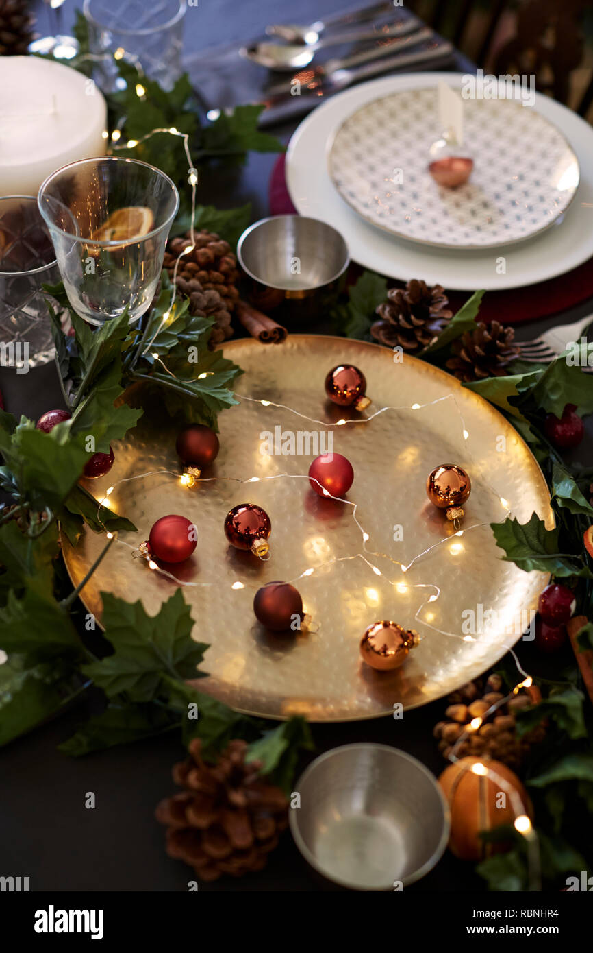 Christmas Table Setting With Baubles On Golden Plate Bauble
