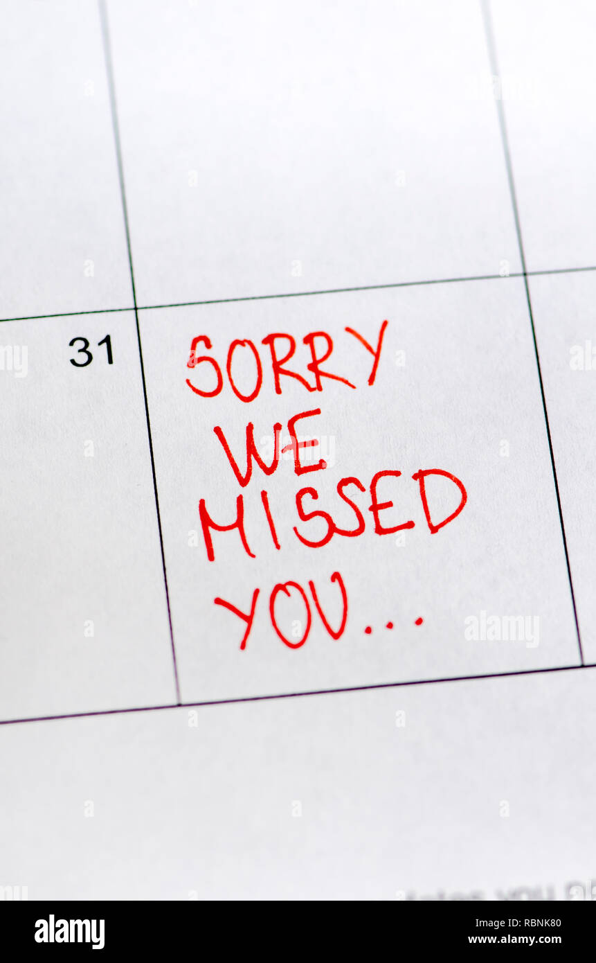 Sorry we missed you message on sticker note pin on calendar date 31st.  Business concept. - Stock Image