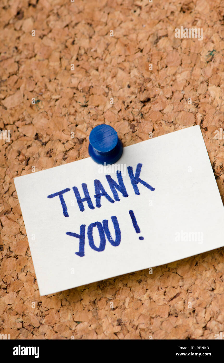 Thank you message on sticker note pin on cork office board. Business concept. - Stock Image