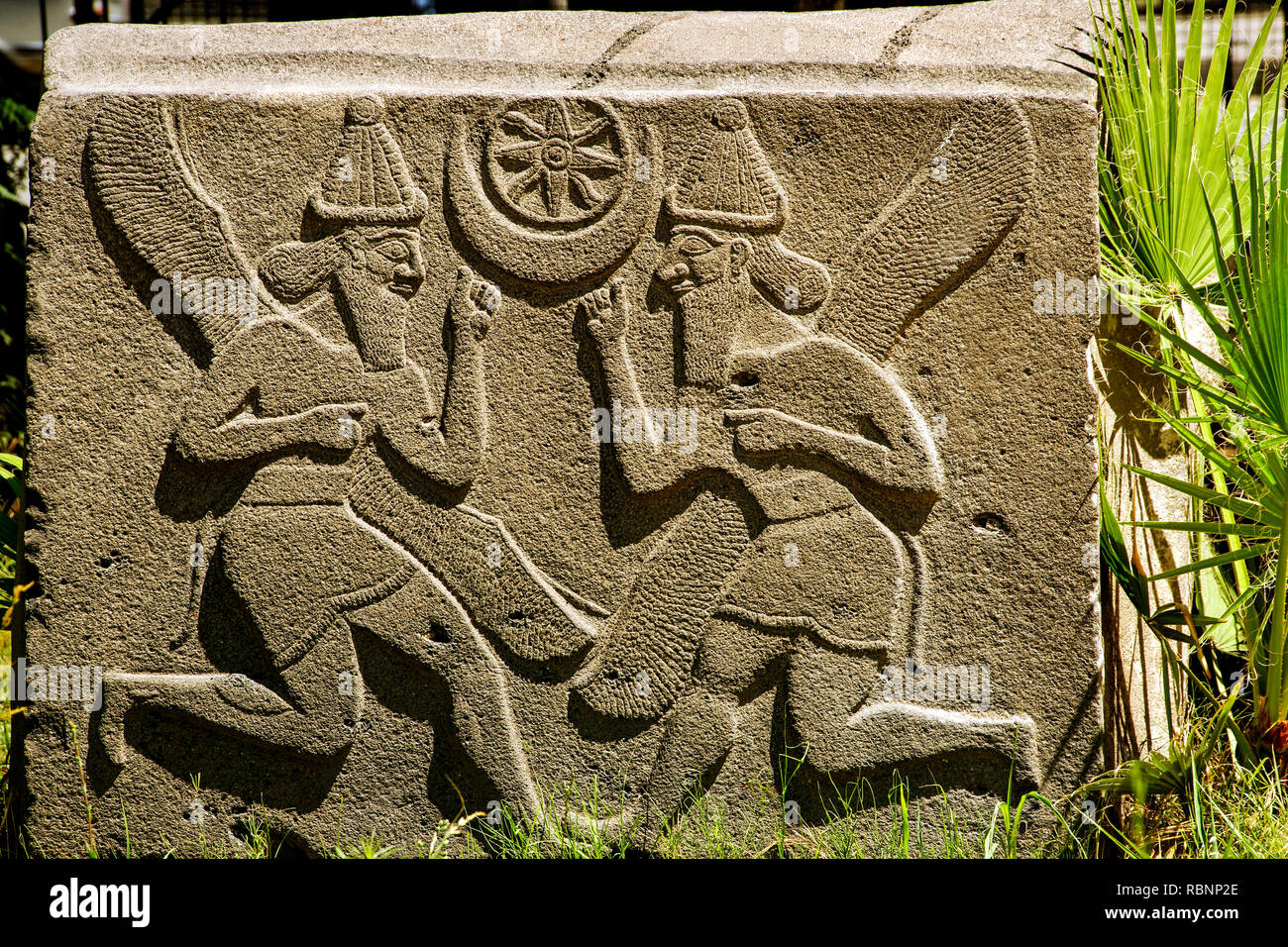 Museum, genius with sun and moon, Neohittit, IXc. BC. Aleppo. Syria, Middle East - Stock Image