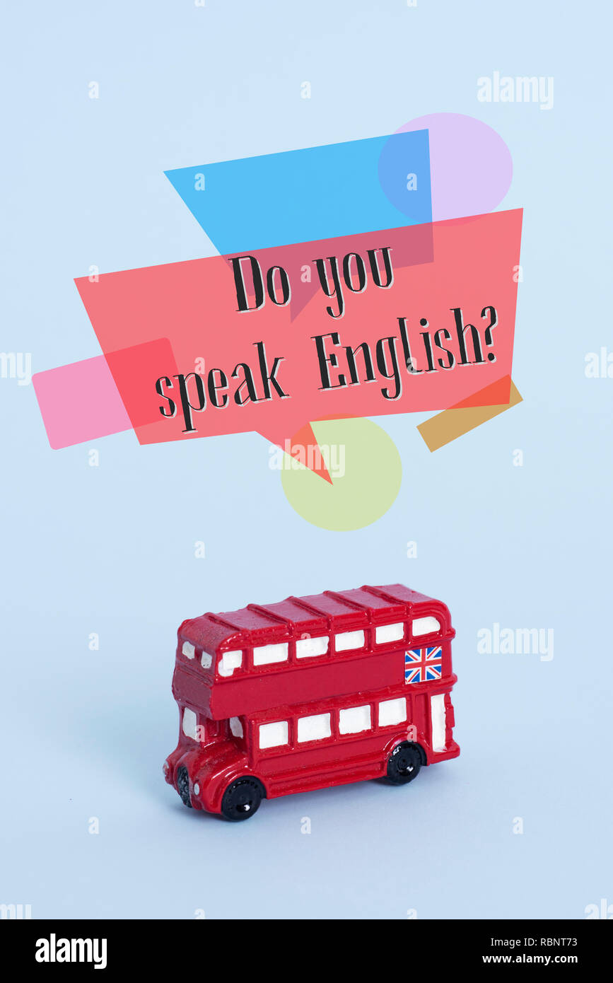 a red double-decker bus, typical of London, United Kingdom, and the question do you speak English? on a blue background Stock Photo
