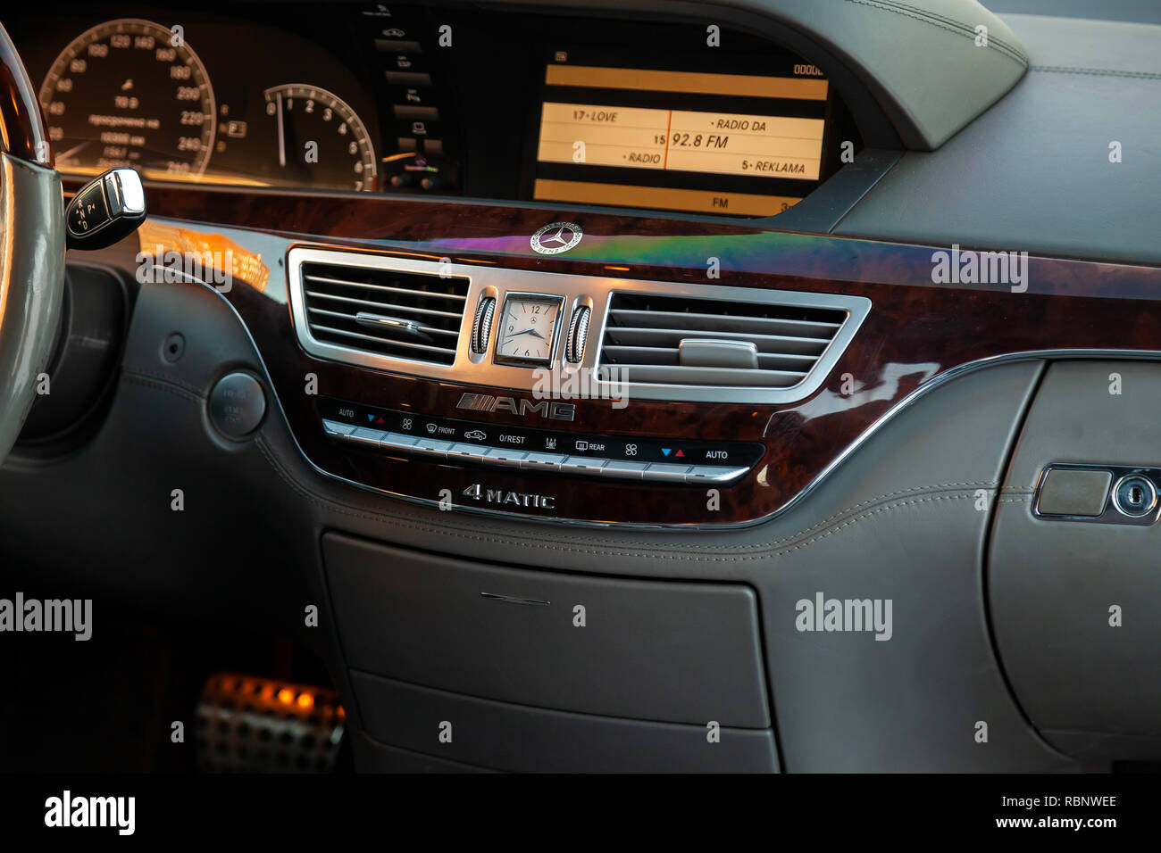 Novosibirsk, Russia - 08.01.2018: Inside the car inside a close-up of a multimedia system with the display on on the central control panel with wood a - Stock Image
