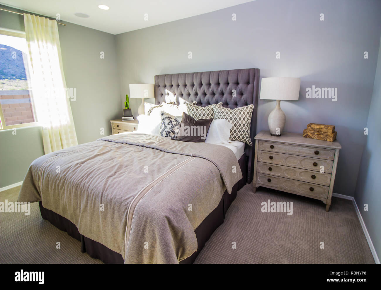 Modern Master Bedroom With Bed Lamps And Nightstands Stock Photo Alamy