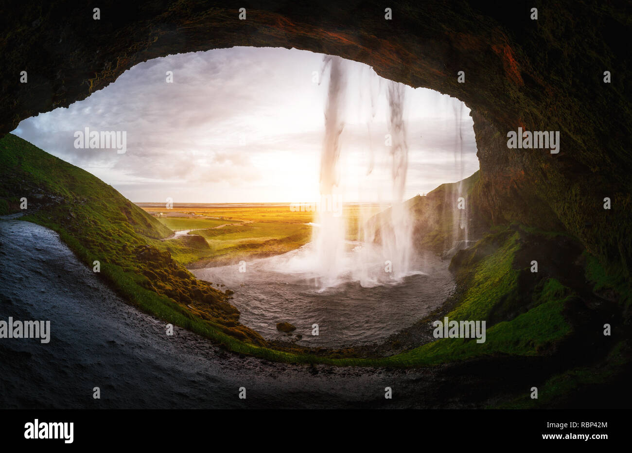 Perfect view of famous powerful Seljalandsfoss waterfall in sunlight. Dramatic and gorgeous scene. Popular tourist attraction. Location place Iceland, Stock Photo