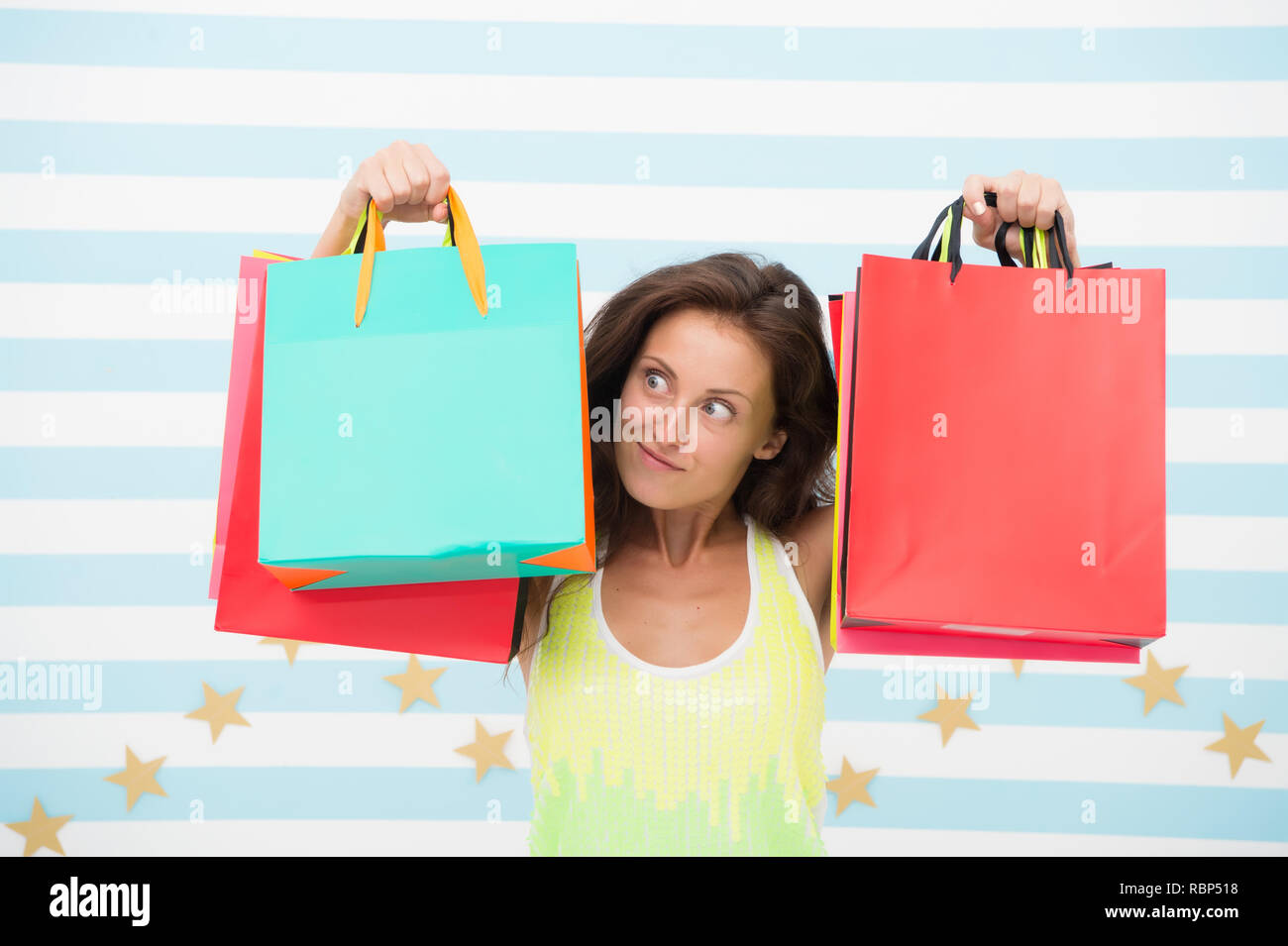 happy shopping. surprised girl with shopping bags on sale, copy space. e commerce marketing and internet ordering purchase. retail therapy for crazy shopaholic. special offer for summer sale - Stock Image