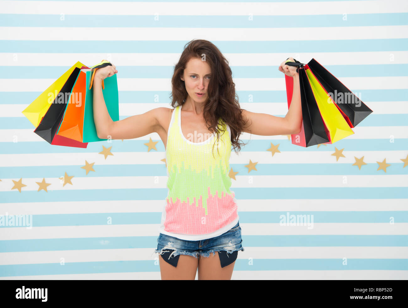 shopping girl with heavy bags. after day shopping. muscular girl hold purchase or present packages. strong shopaholic hold heavy bags. sale benefit. i want this. i need some retail therapy - Stock Image