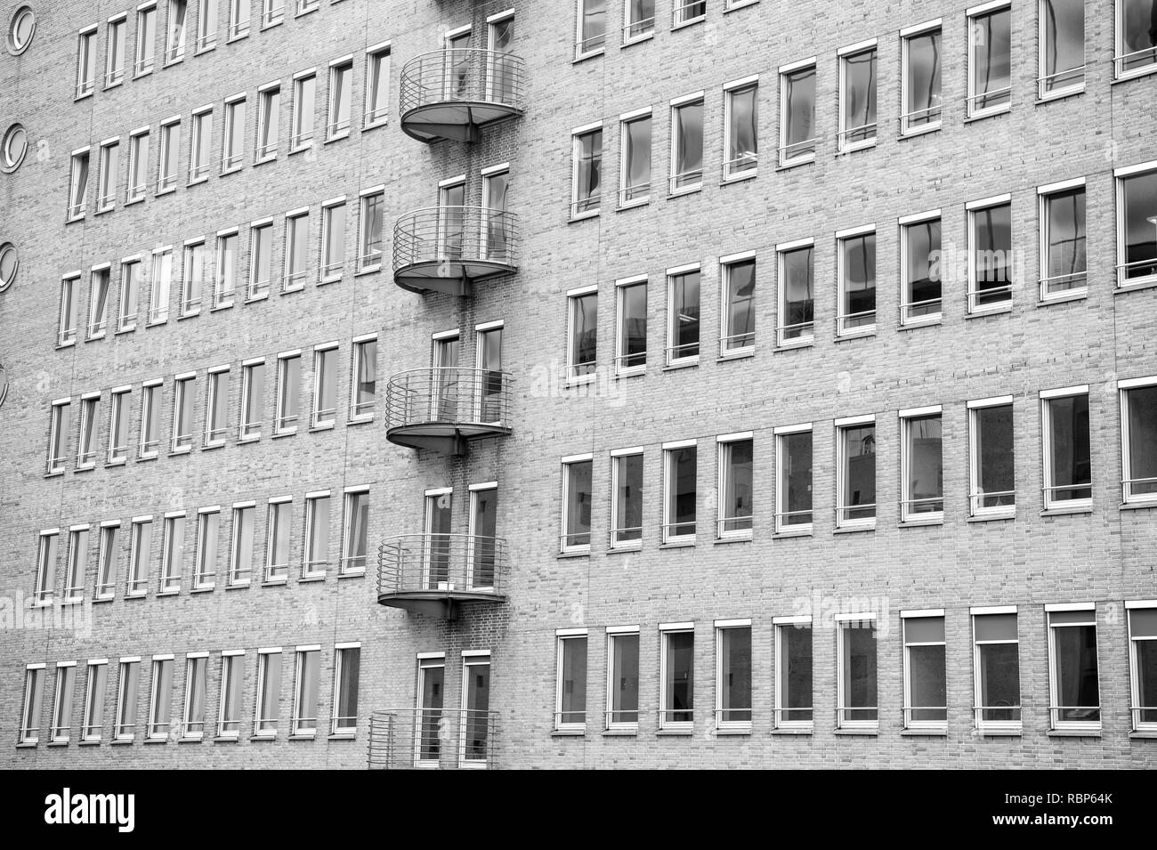 Building facade wall background of red bricks with windows in Hamburg, Germany. Business center, district. Architecture, structure, design. - Stock Image